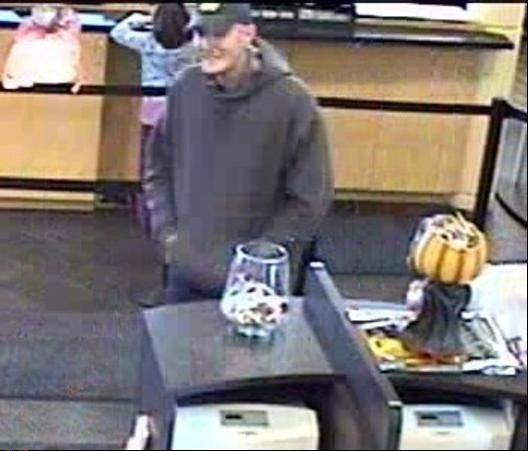 Authorities say this man in a hooded sweatshirt and baseball cap robbed a TCF Bank in Rolling Meadows on Friday afternoon.