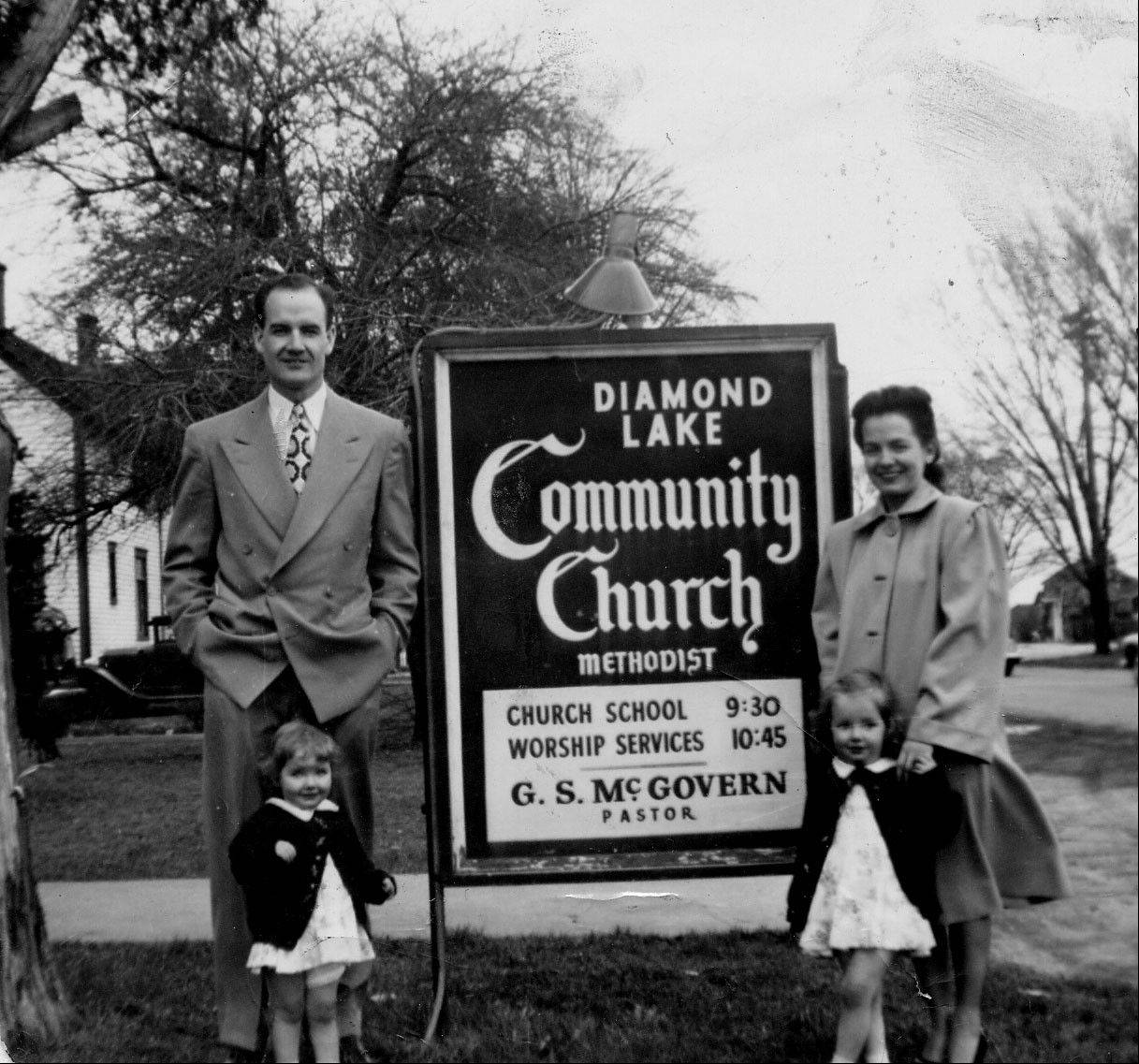 George and Eleanor McGovern with daughters Ann and Susan at the church where he served as student pastor.