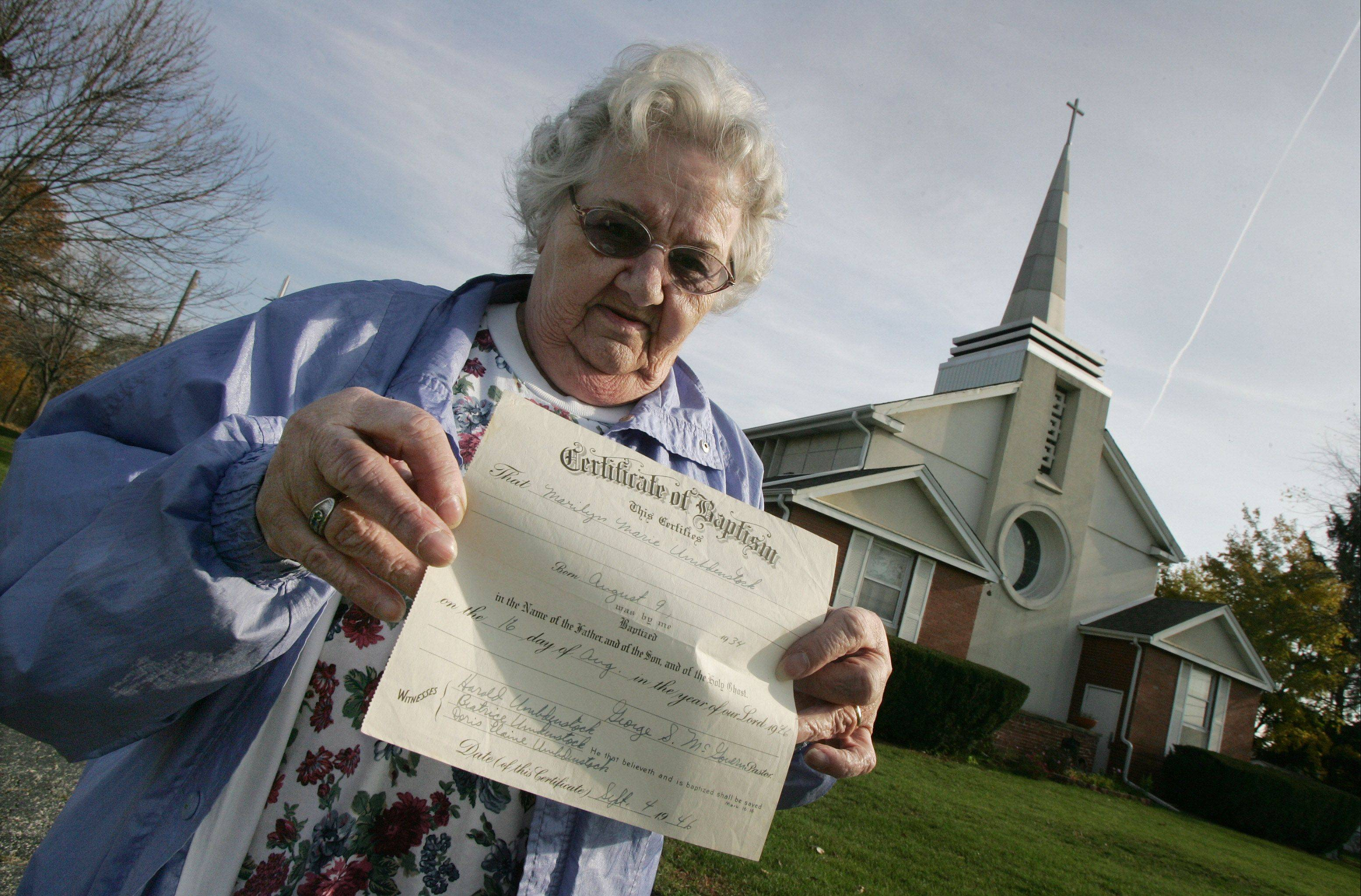 Marilyn Gillies holds the Certificate of Baptism signed by three-time presidential candidate George S. McGovern, who in parts of 1946 and 1947 was a student pastor at the former Diamond Lake Methodist Church in Mundelein.