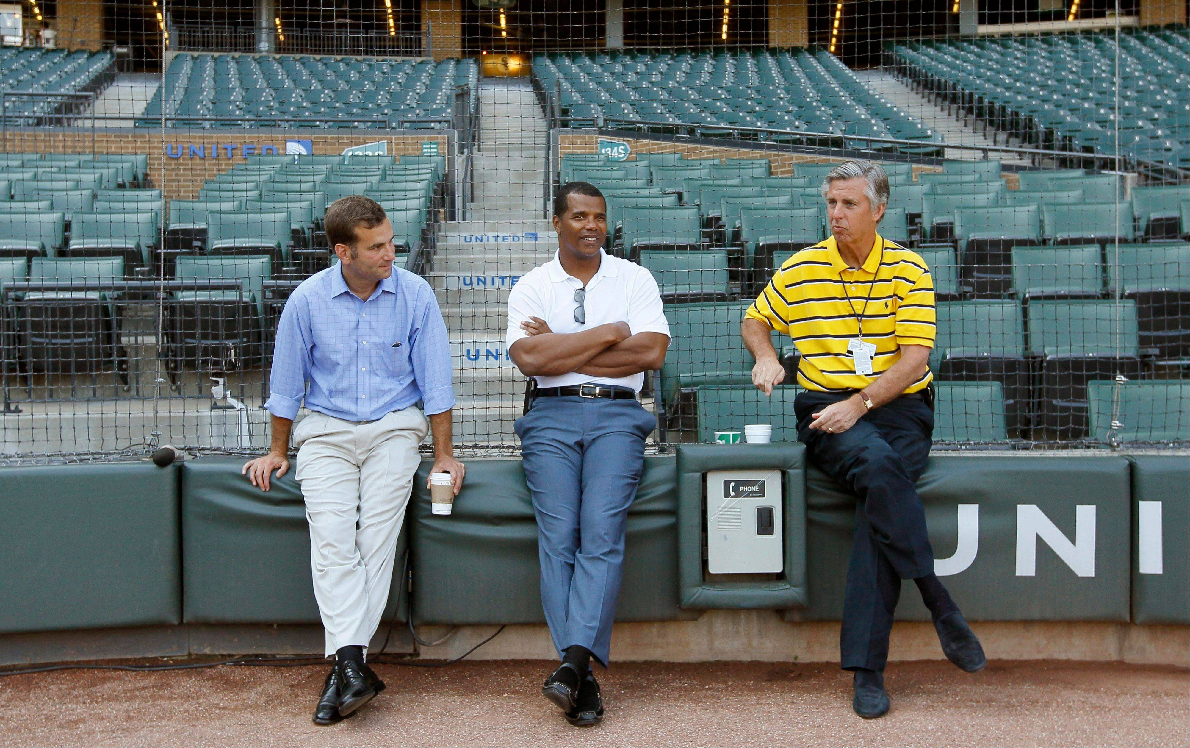 Kenny Williams, center, Rick Hahn, left, listen to Detroit Tigers general manager David Dombrowski in July 2011.
