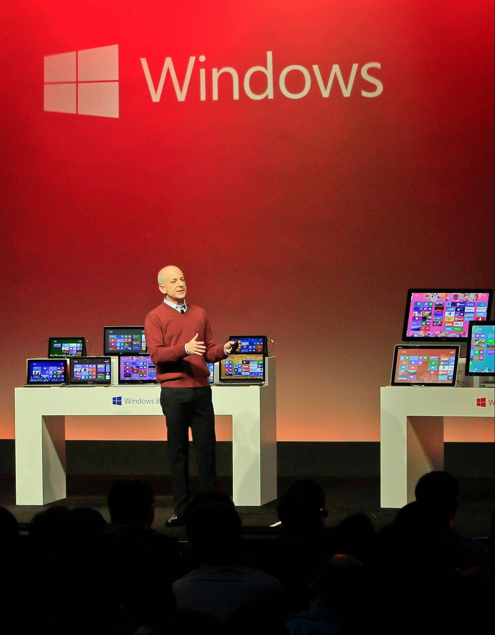 Steven Sinofsky, president of the Windows and Windows Live Division at Microsoft, speaks Tuesday during a preview of the new operating system Windows 8 and tablet computer Surface in Shanghai.