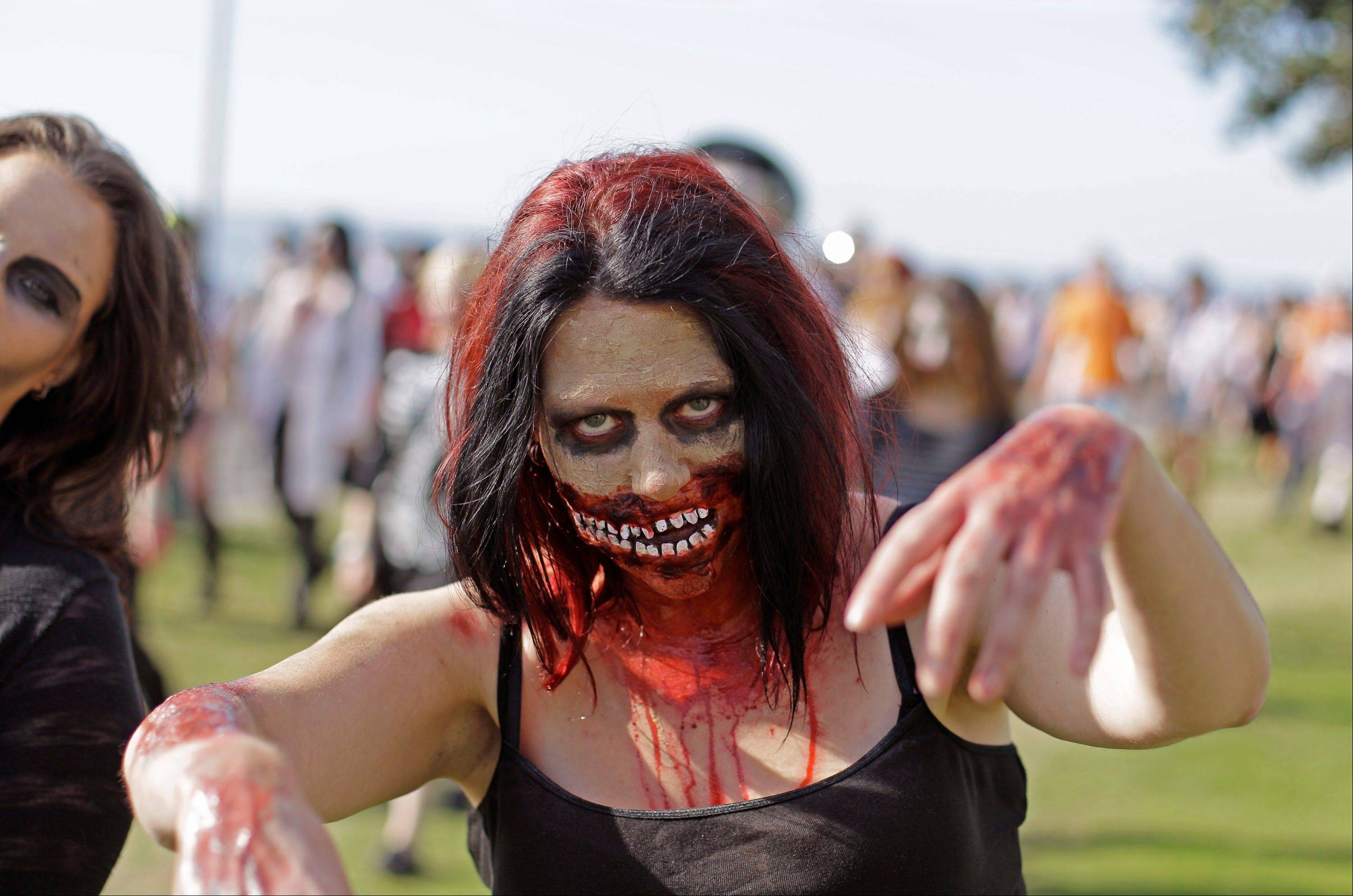 Associated Press A woman walks like a zombie Saturday as she and others take part in Zombie Walk in Cape Town, South Africa. The Homeland Security Department told citizens last month, if they're prepared for a zombie attack, they'll be ready for real-life disasters like a hurricane, pandemic, earthquake or a terrorist attack.