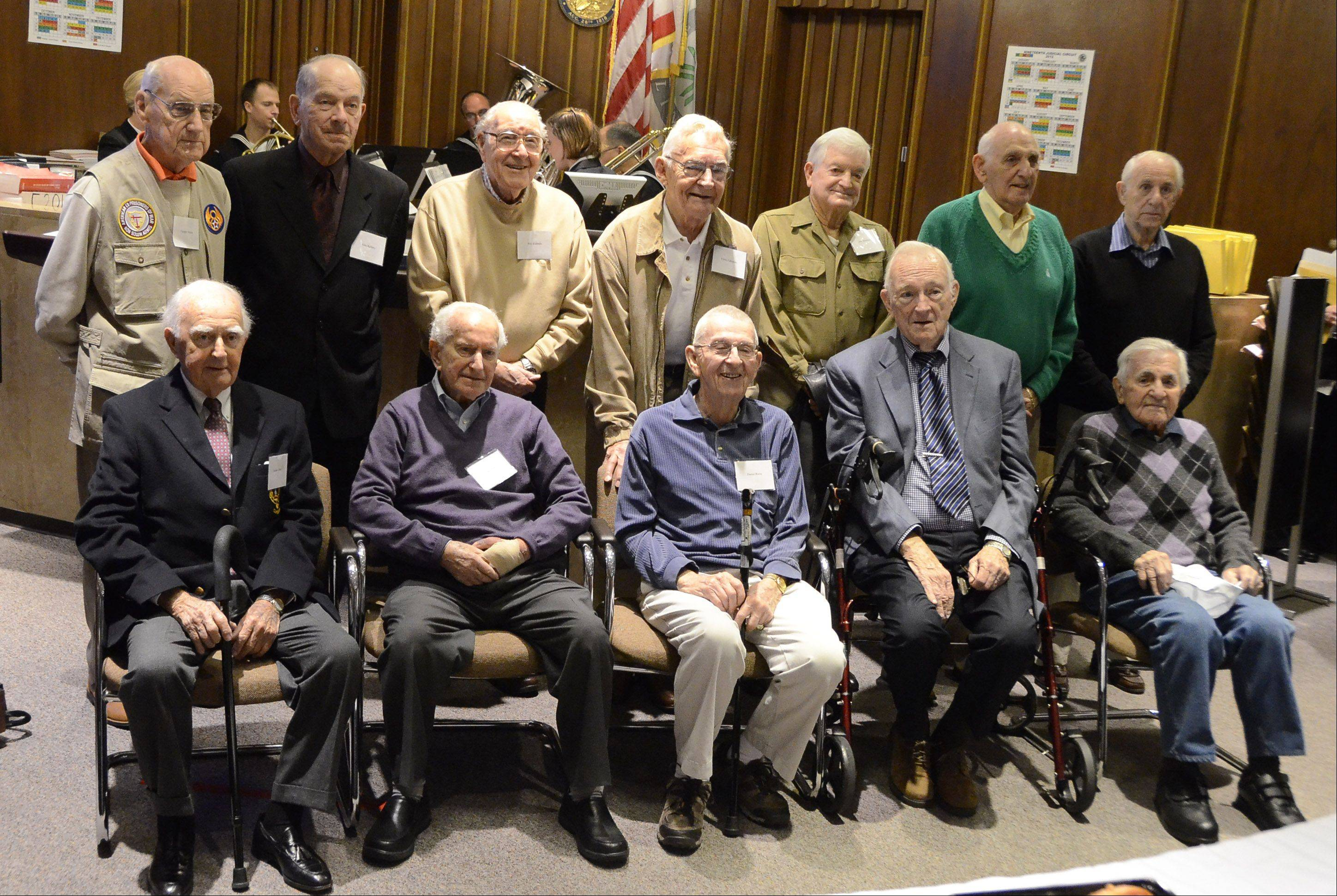 Combat veterans get together for a photograph Friday morning at the Lake County courthouse in Waukegan. Members of the legal community met with the veterans to help record their stories for the Library of Congress.