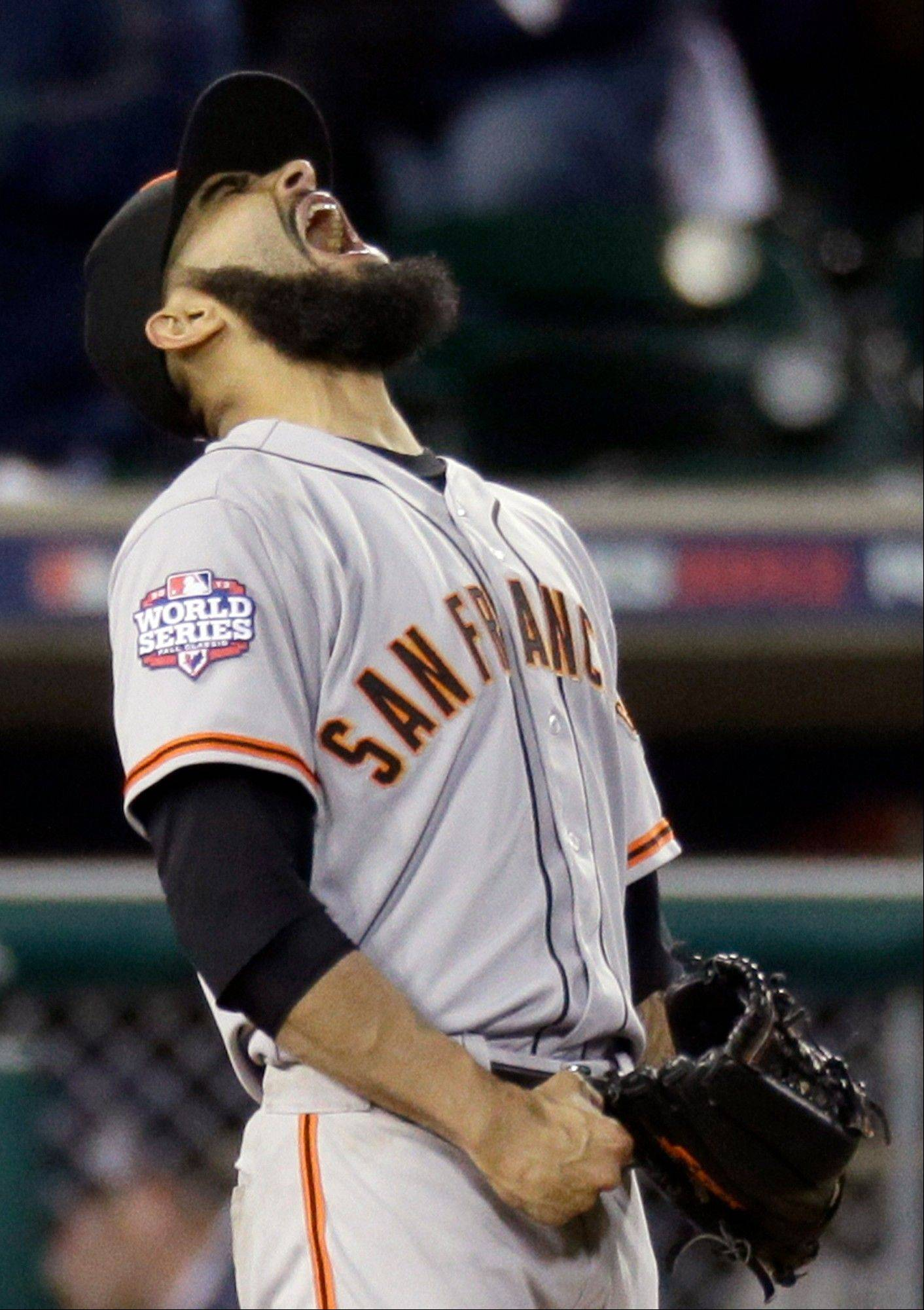 San Francisco Giants relief pitcher Sergio Romo celebrates after San Francisco Giants beat Detroit Tigers 2-0 in Game 3 of baseball's World Series Saturday, Oct. 27, 2012, in Detroit. The Giants lead the series 3-0. (AP Photo/Carlos Osorio)