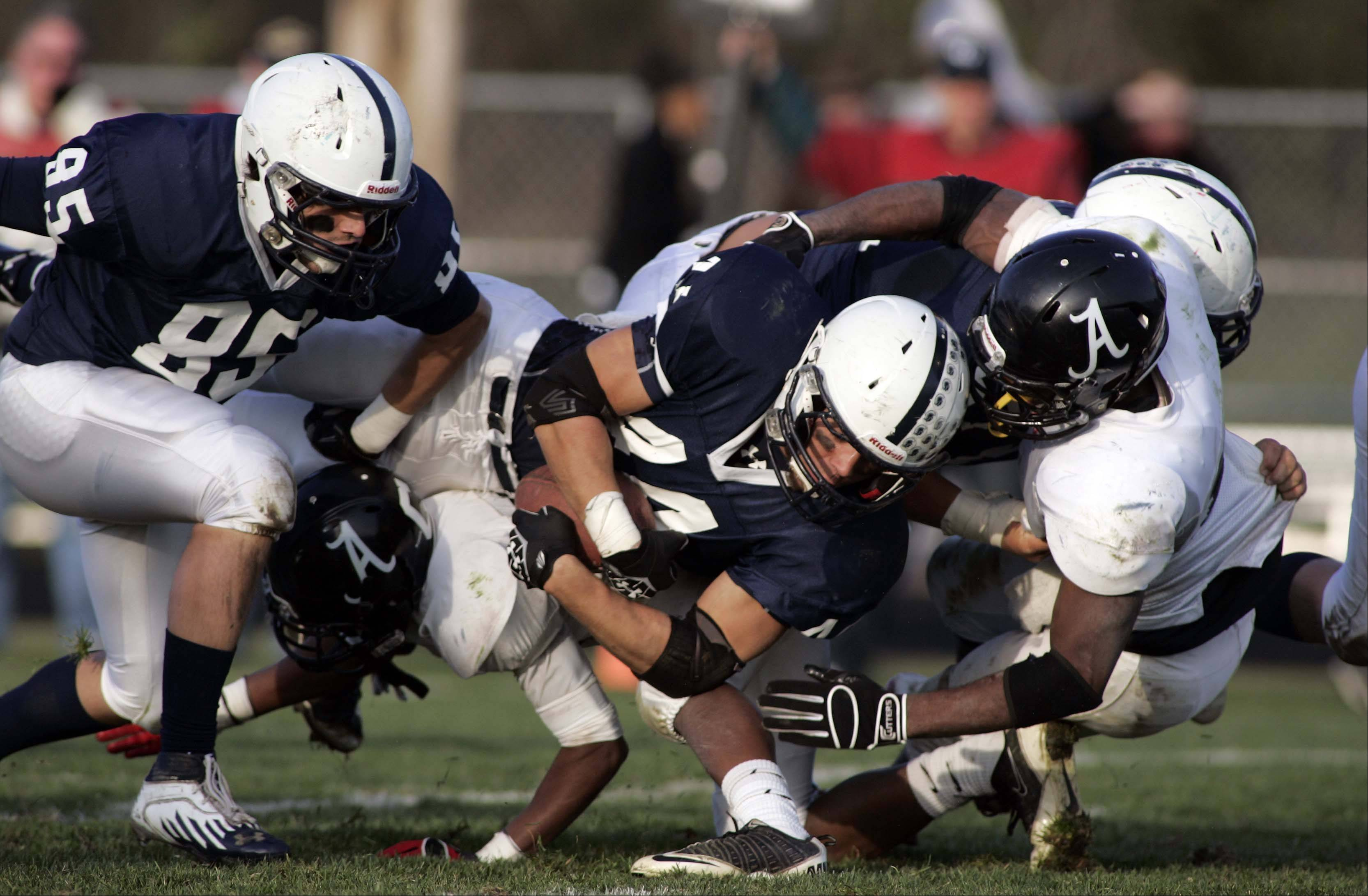 Cary-Grove's Kyle Norberg (44) is pulled down close to the goal line during the second quarter during Rockford Auburn at Cary-Grove in IHSA Class 6A playoff Football Saturday October 27, 2012.