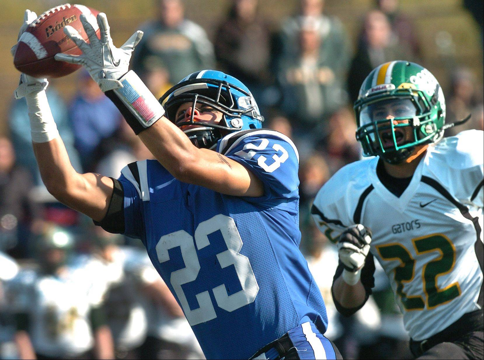Lake Zurich's Grant Soucy hauls in a 56-yard bomb on the first series of the game, setting up the first touchdown, on their way to routing Crystal Lake South during the Class 7A state playoff opener.