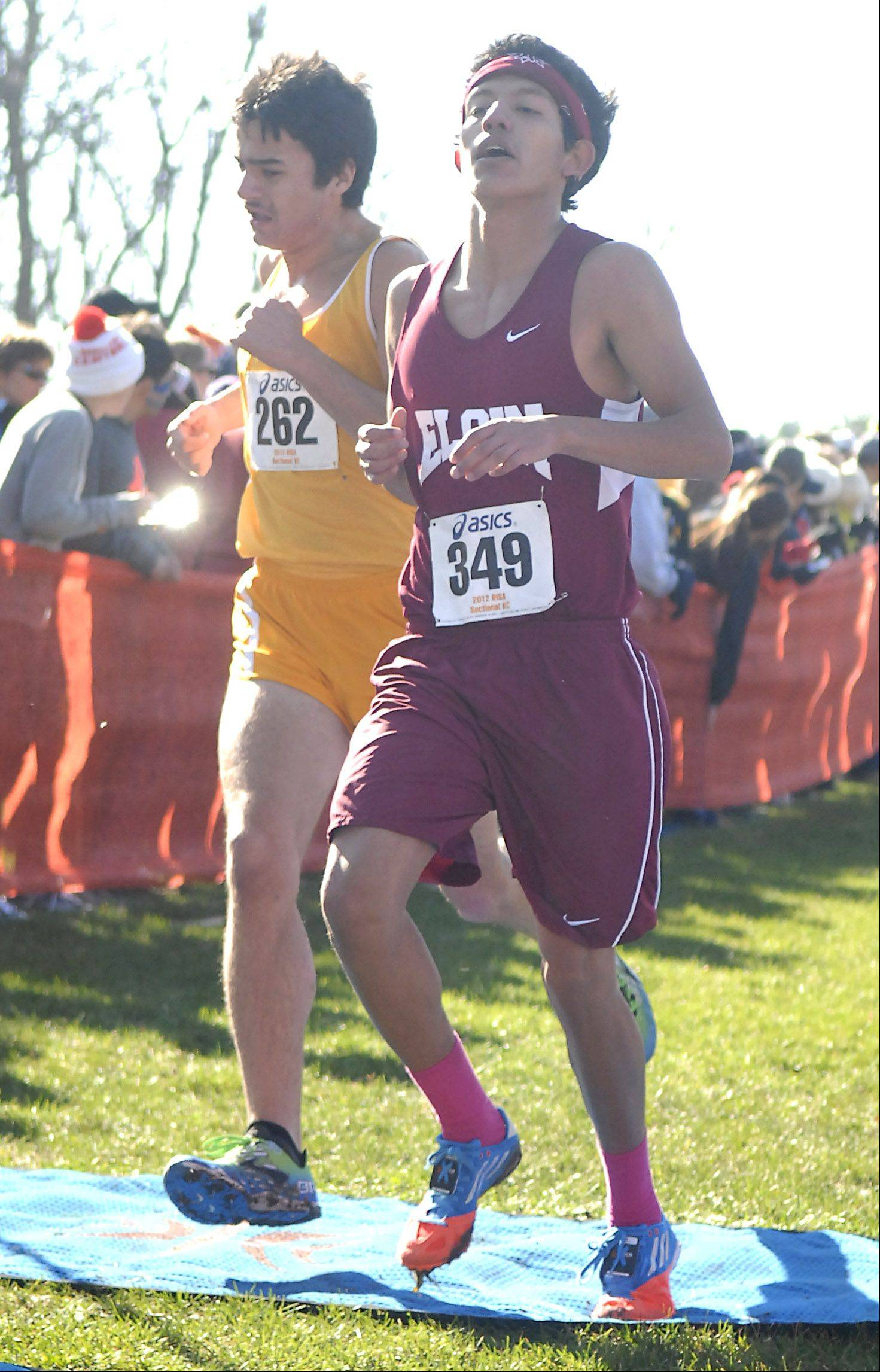 Elgin's Cristain Martinez crosses the finish line in the St. Charles East cross country sectional at LeRoy Oakes in St. Charles on Saturday, October 27.