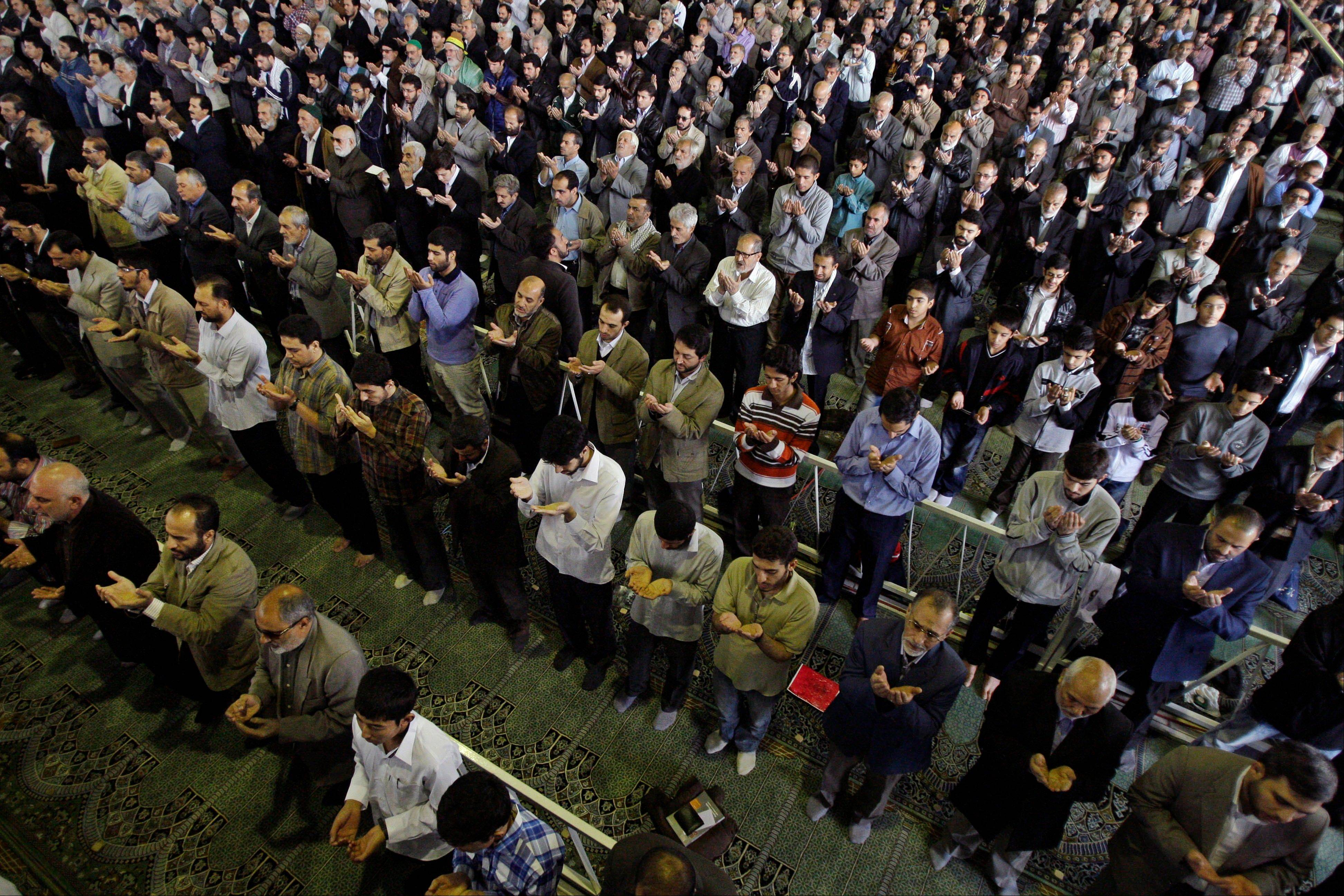 Iranian worshippers perform their Eid al-Adha prayers Friday at Tehran University campus in Tehran, Iran. Leaders in Iran are appealing to Iranians sense of nationalism in an effort to encourage them to purchase domestic products.