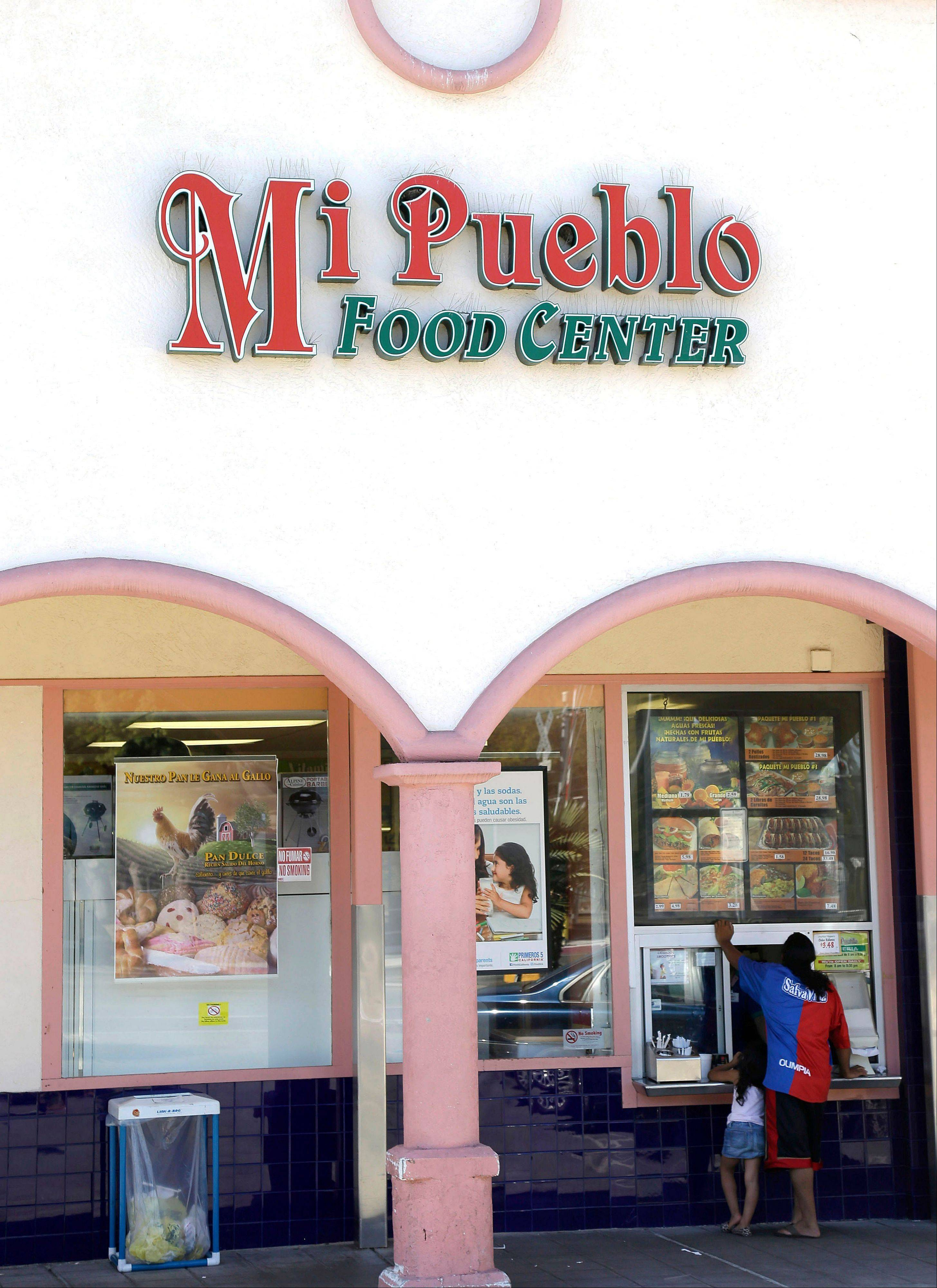 Associated Press/Oct. 17, 2012Customers order food at Mi Pueblo Foods store in Mountain View, Calif.
