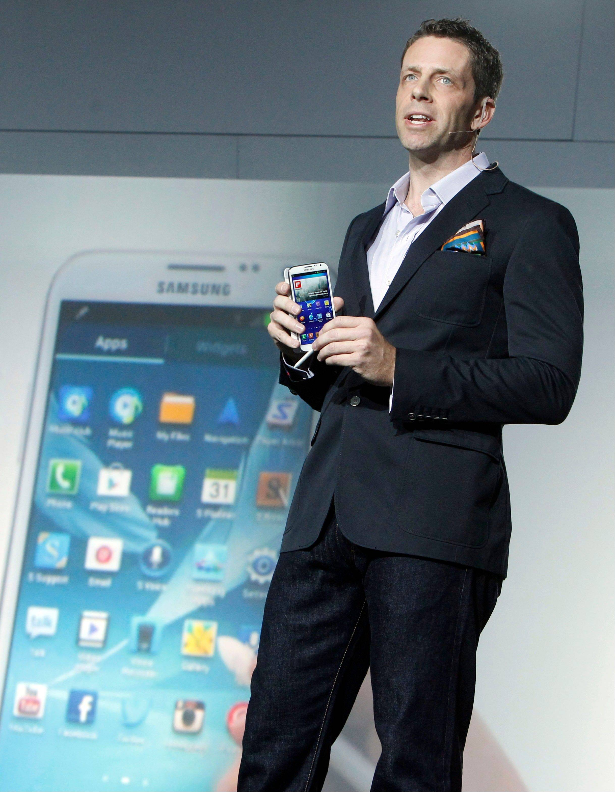 Kevin Packingham, chief product officer for Samsung Mobile USA, demonstrates the new Samsung Galaxy Note II Wednesday during a launch event in New York.