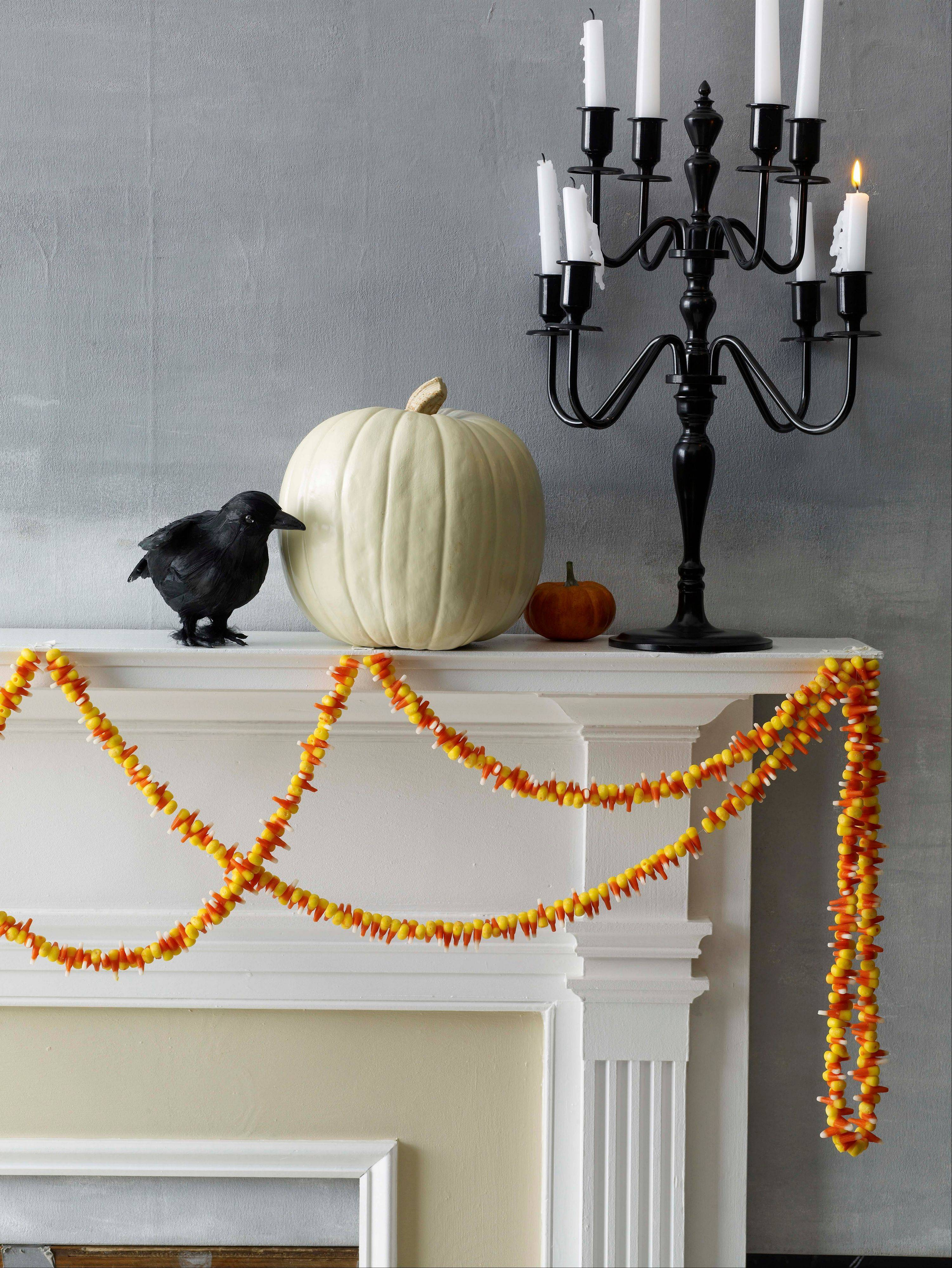 A garland threaded with candy corn makes a colorful decoration for Halloween.