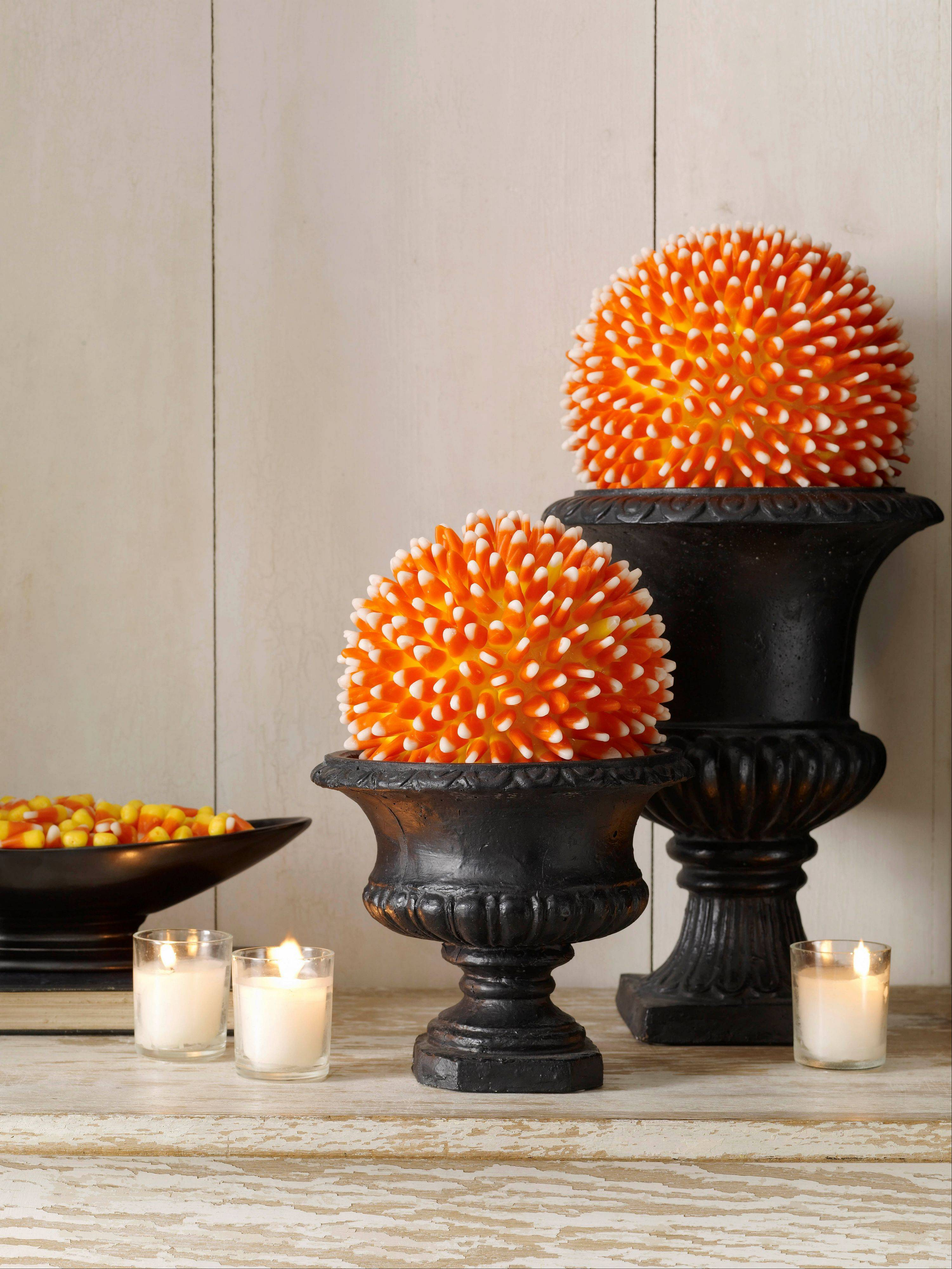 Create this candy corn centerpiece with a hot glue gun and a bag of candy corn along with a Styrofoam ball or cone shape. Instructions are available at womansday.com.