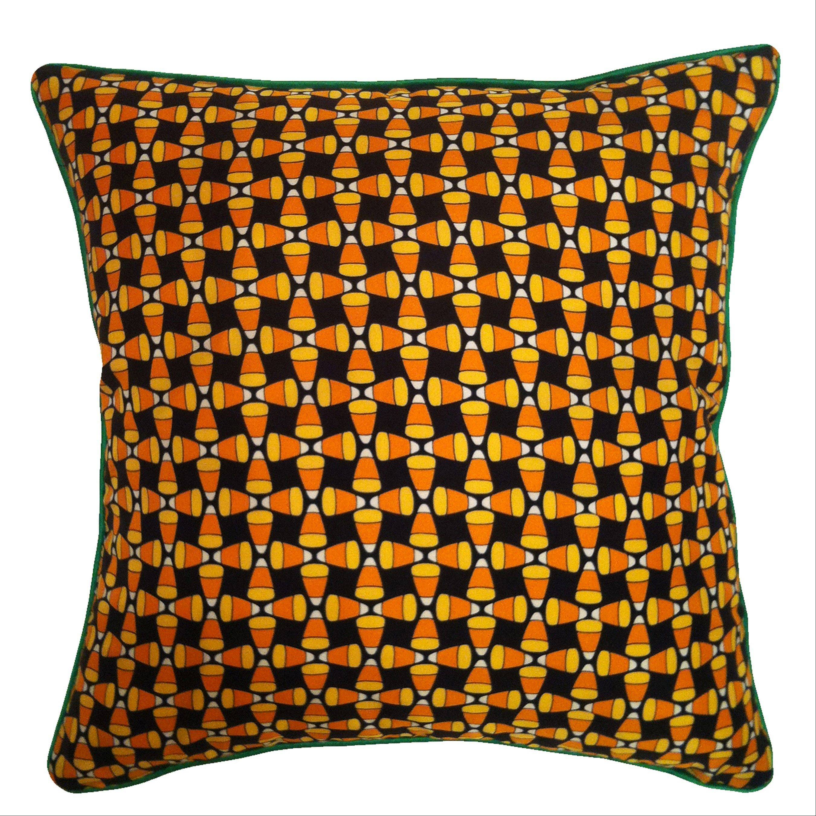 A silk pillow ($115) with a candy corn print showcases Halloween as seasonal decor.