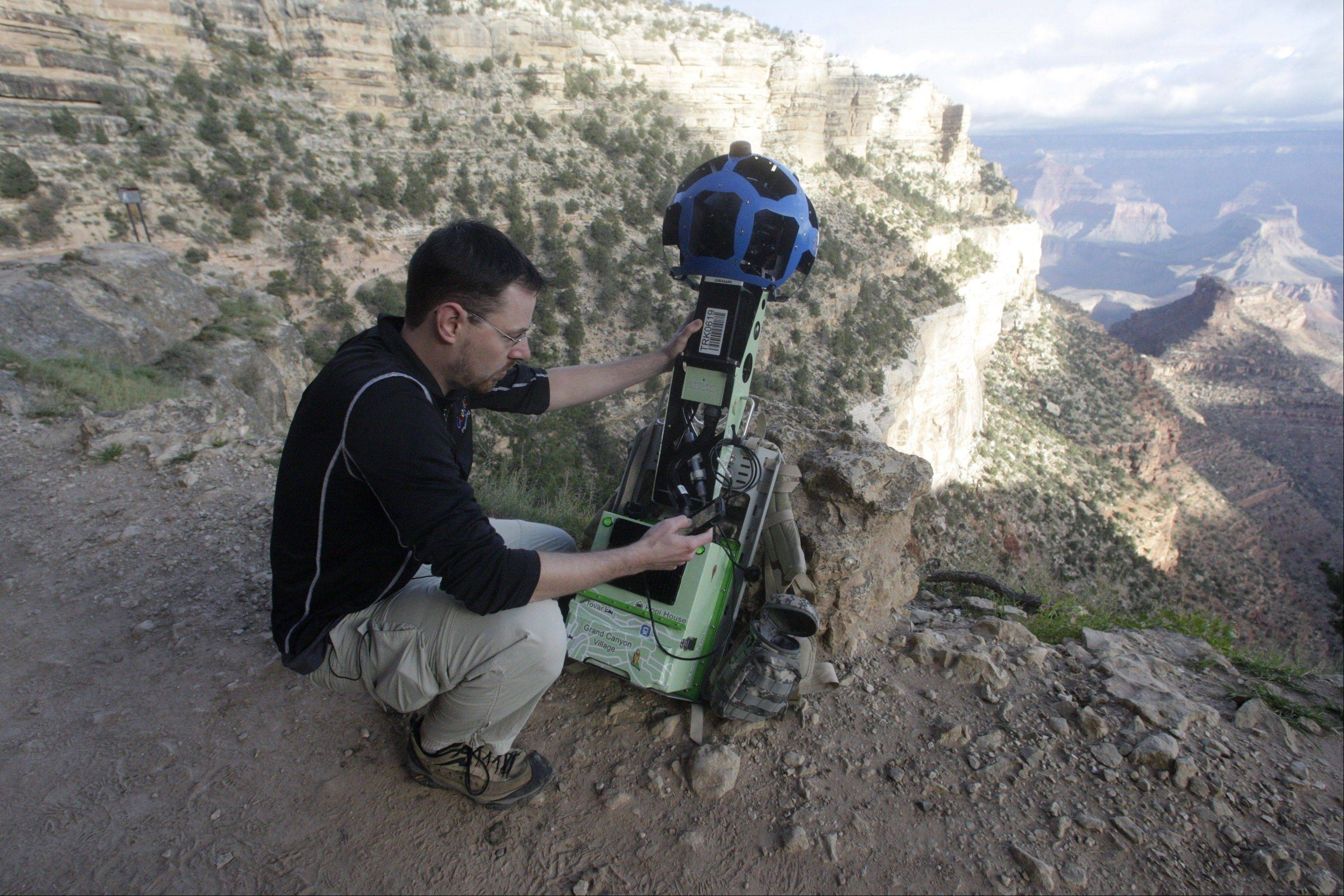 Google product manager Ryan Falor works with the Trekker during a demonstration for the media along the Bright Angel Trail at the South Rim of the Grand Canyon National Park. The search engine giant is using the nearly 40-pound, backpack-sized camera unit to showcase the Grand Canyon's most popular hiking trails on the South Rim and other off-road sites.