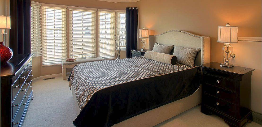 The master bedroom focal point is the Wing Man bed. The window treatment includes black silk side panels.