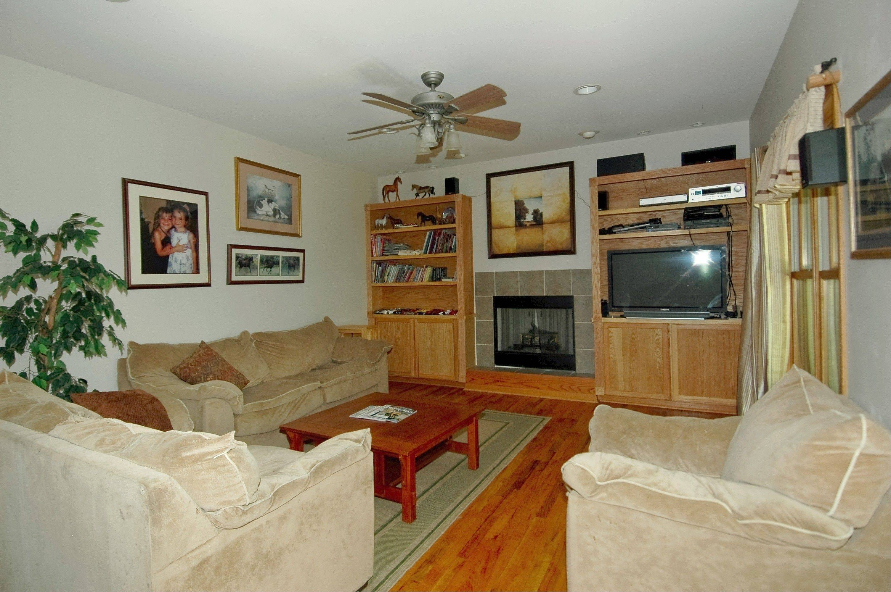 There are hardwood floors and a gas fireplace in the first-floor family room.