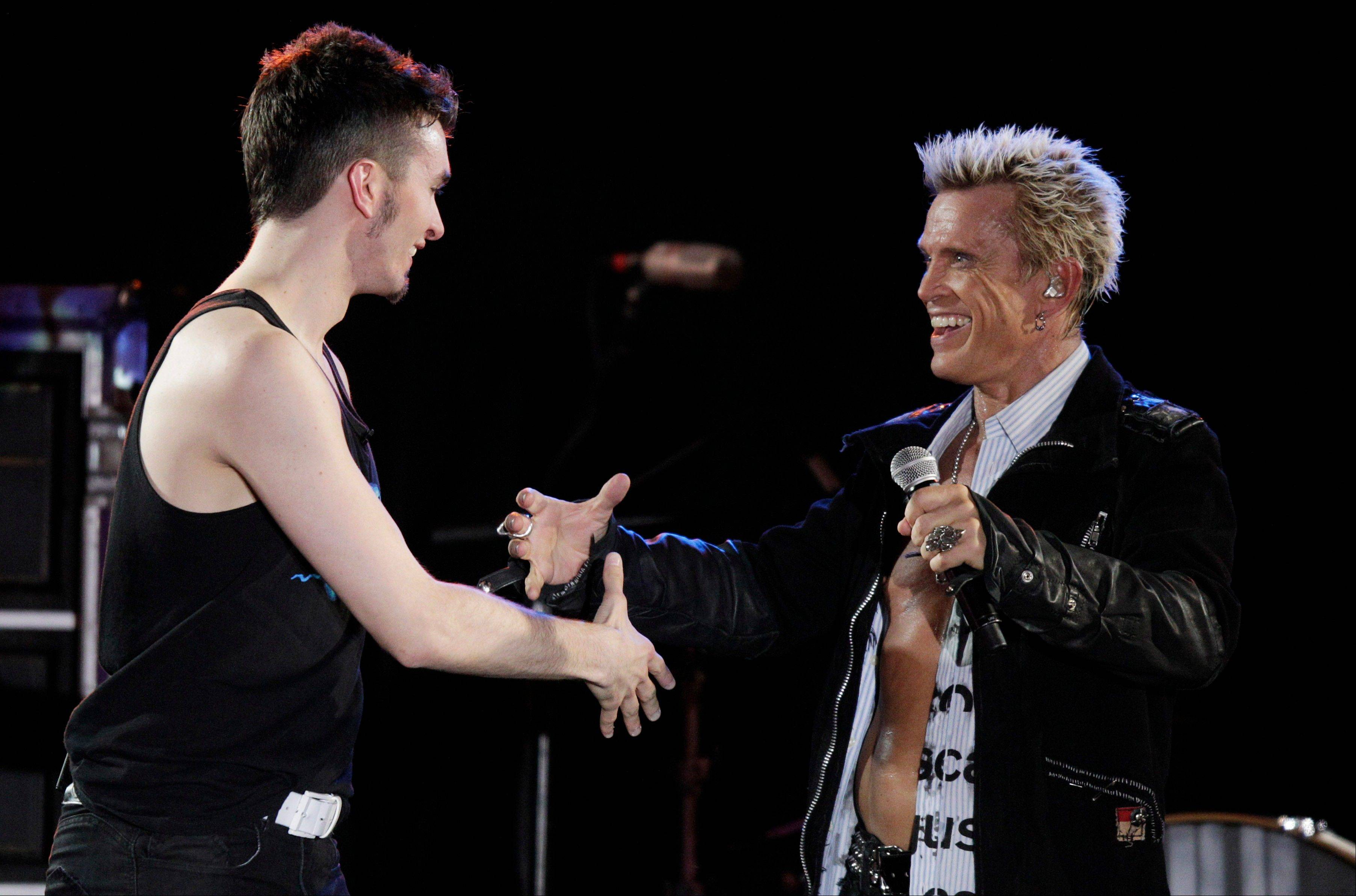 Associated Press Billy Idol, right, and Michael Henrichsen meet on stage.