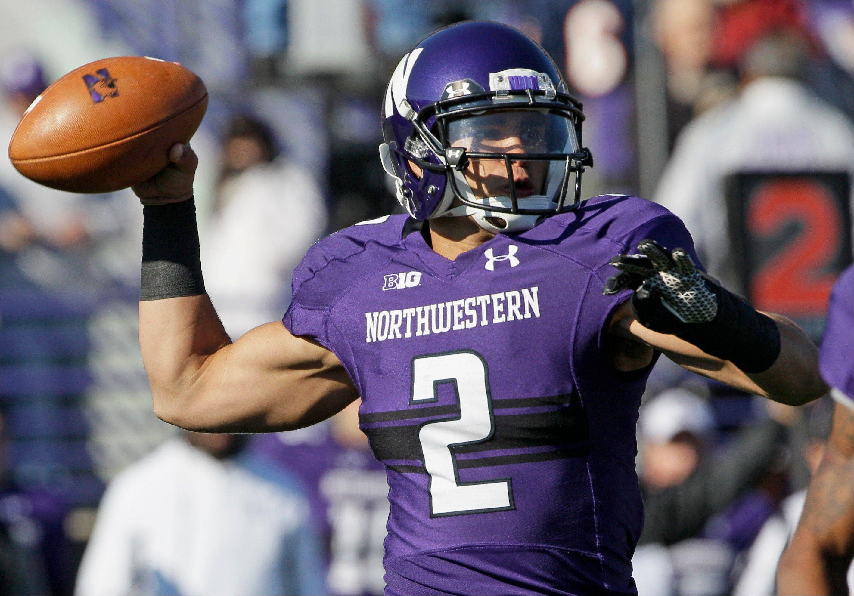 Northwestern quarterback Kain Colter (2) looks to a pass during the first half against Iowa in Evanston.