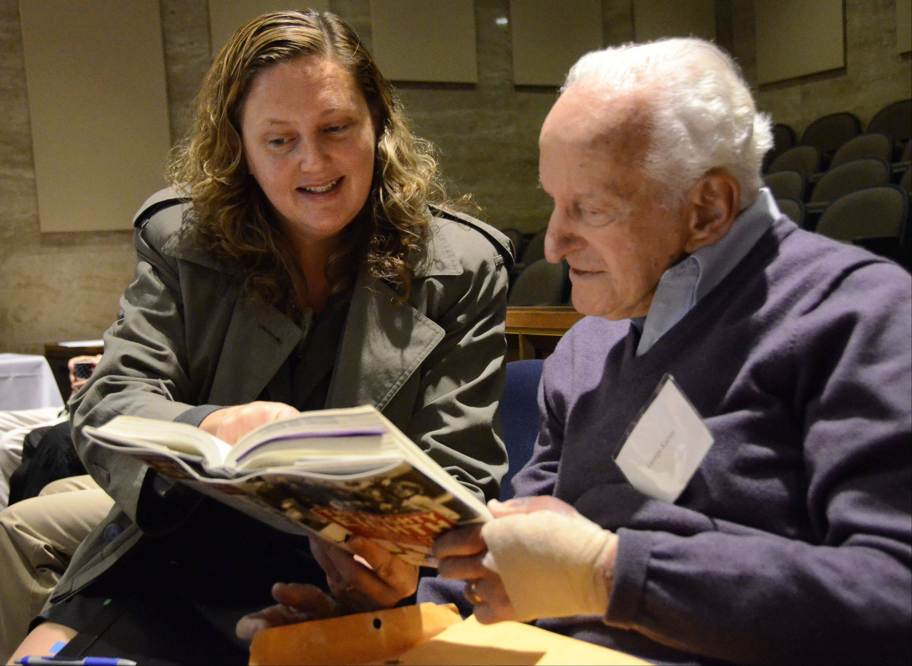 Assistant State's Attorney Janelle Christensen talks with World War II Air Force veteran George Kaiser of Lake Forest.