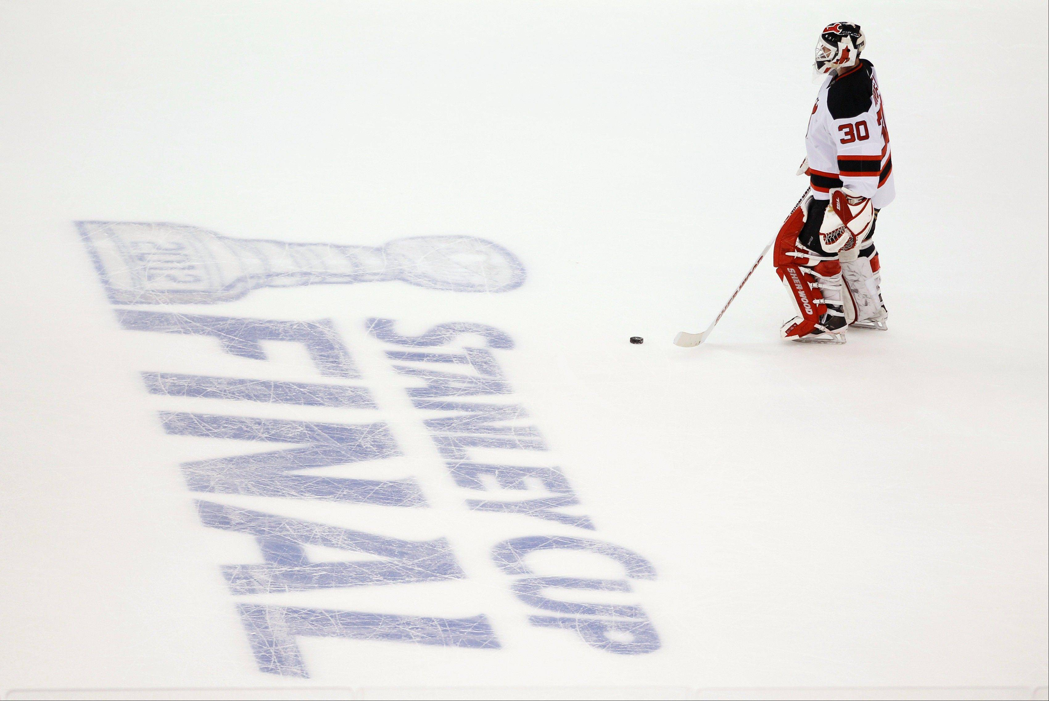 FILE - In this June 11, 2012, file photo, New Jersey Devils goalie Martin Brodeur skates towards center ice during a timeout in the second period against the Los Angeles Kings during Game 6 of NHL hockey's Stanley Cup finals in Los Angeles. The NHL announced Friday, Oct. 26, 2012, that it has canceled all its games through the end of November because of the labor dispute between owners and players.