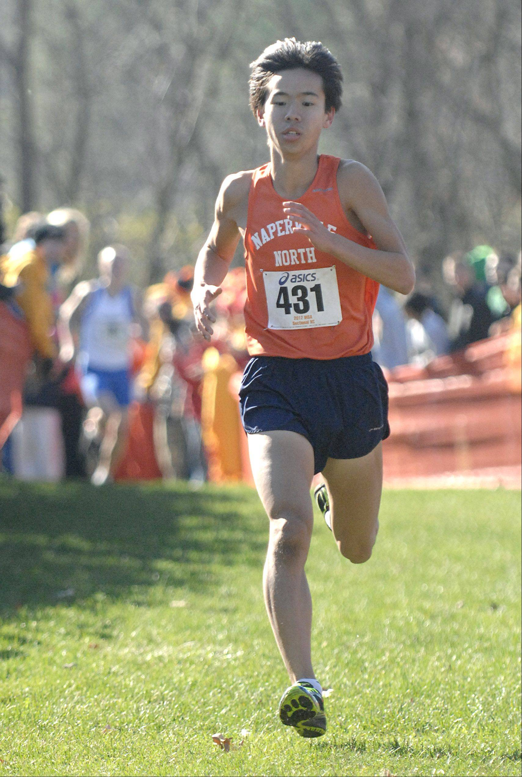 Naperville North's Jimmy Qiao nears the finish line to be the first to cross in the St. Charles East cross country sectional at LeRoy Oakes in St. Charles on Saturday, October 27.