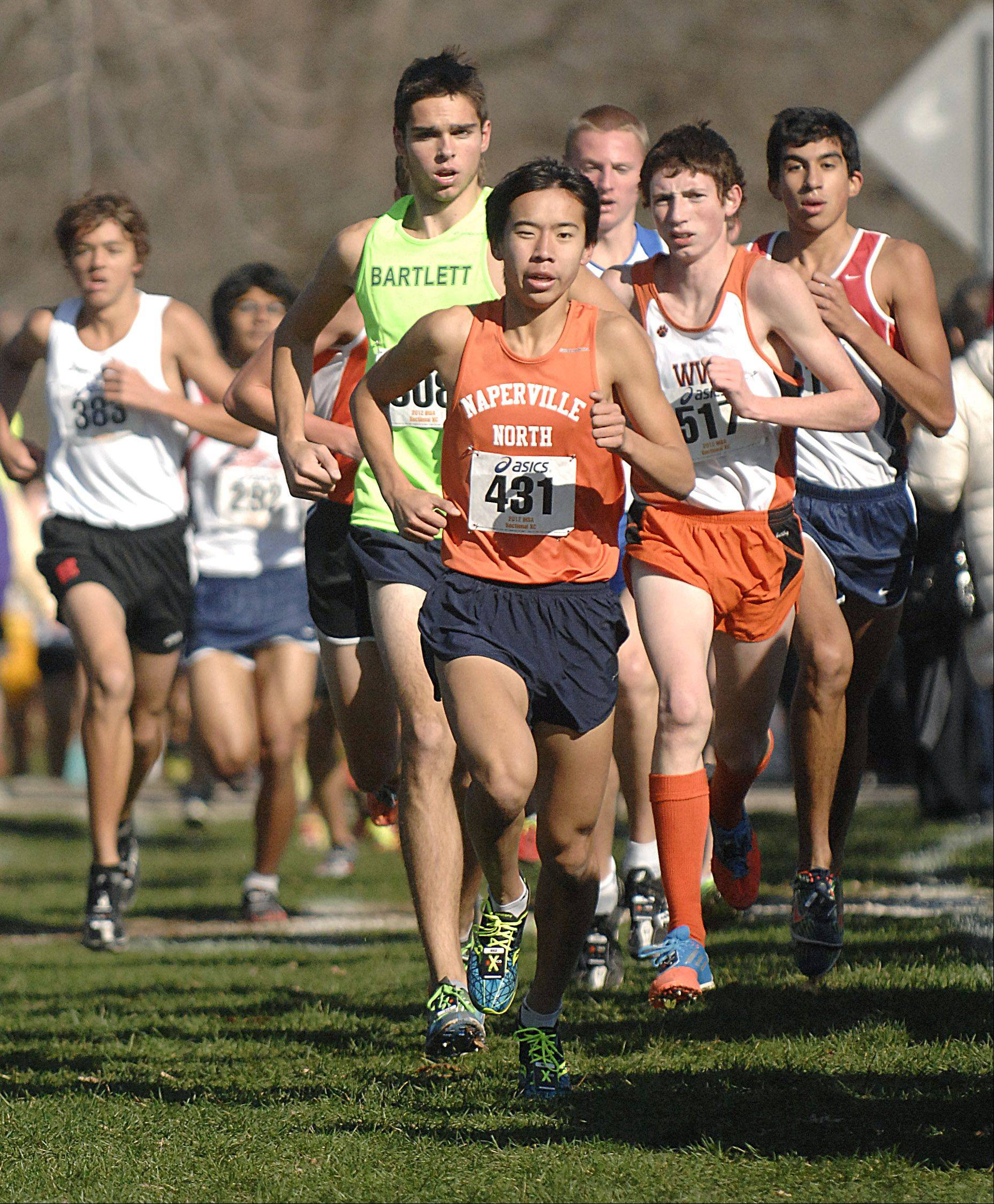 Naperville North's Jimmy Qiao leads the pack with Bartlett's Connor Rachford behind him near the mile and half mark in the St. Charles East cross country sectional at LeRoy Oakes in St. Charles on Saturday, October 27.