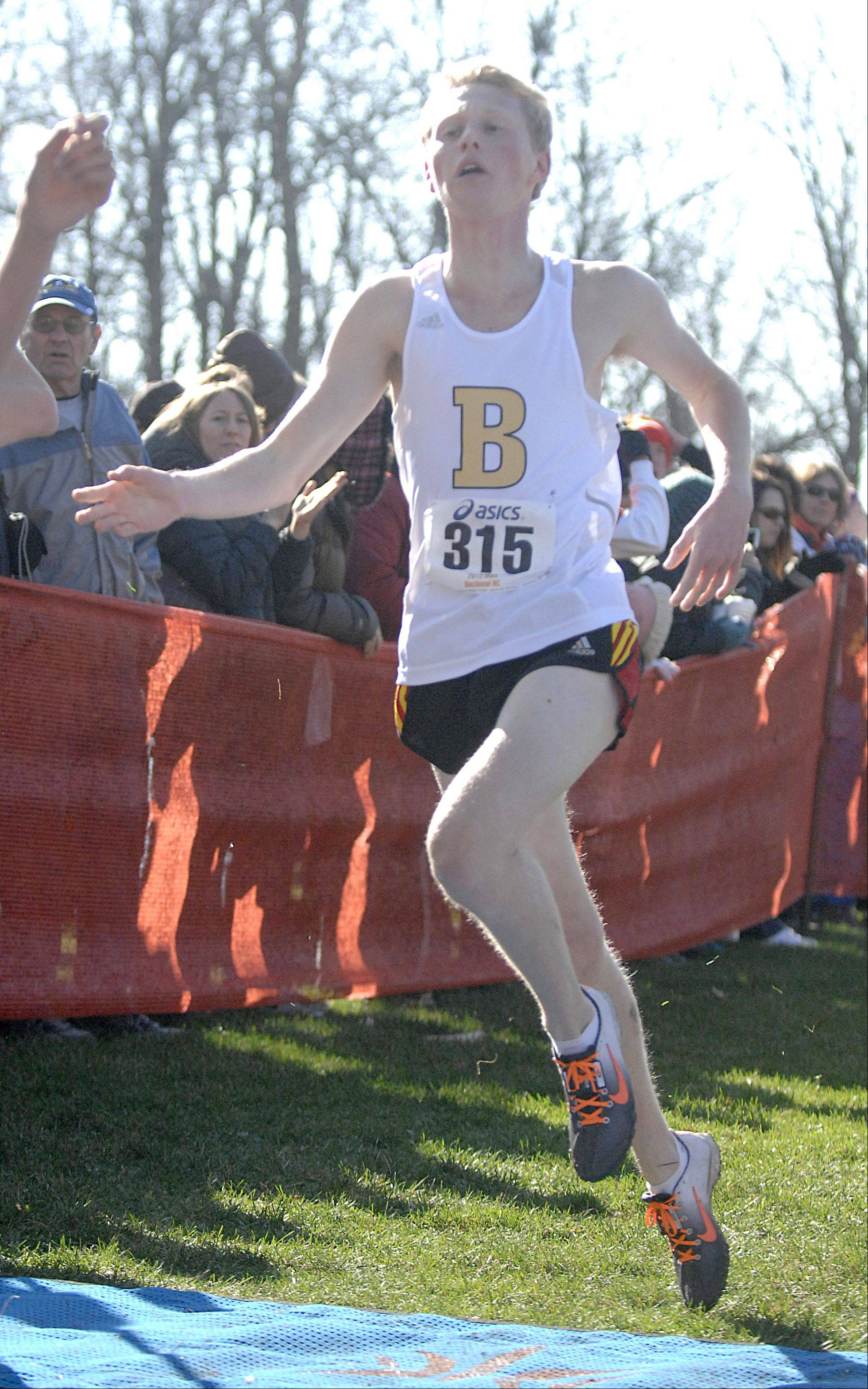 Batavia's Trevor Hollis crosses the finish line in the St. Charles East cross country sectional at LeRoy Oakes in St. Charles on Saturday, October 27.