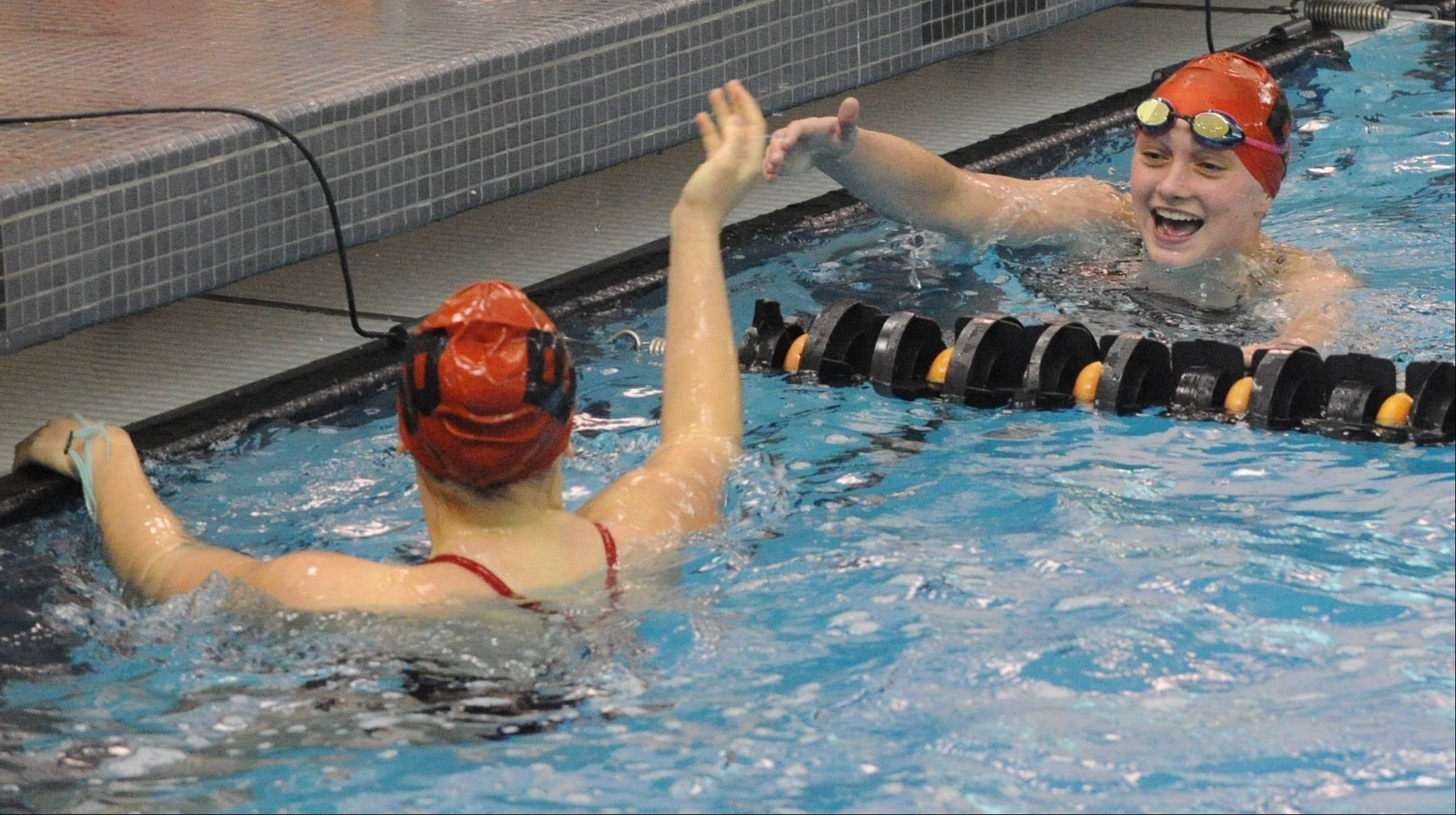 Barrington's Mekenna Scheitlin, right, and teammate Olivia Hoffman celebrate a 1-2 finish in the 100-yard butterfly during Saturday's Mid-Suburban League meet at Barrington.