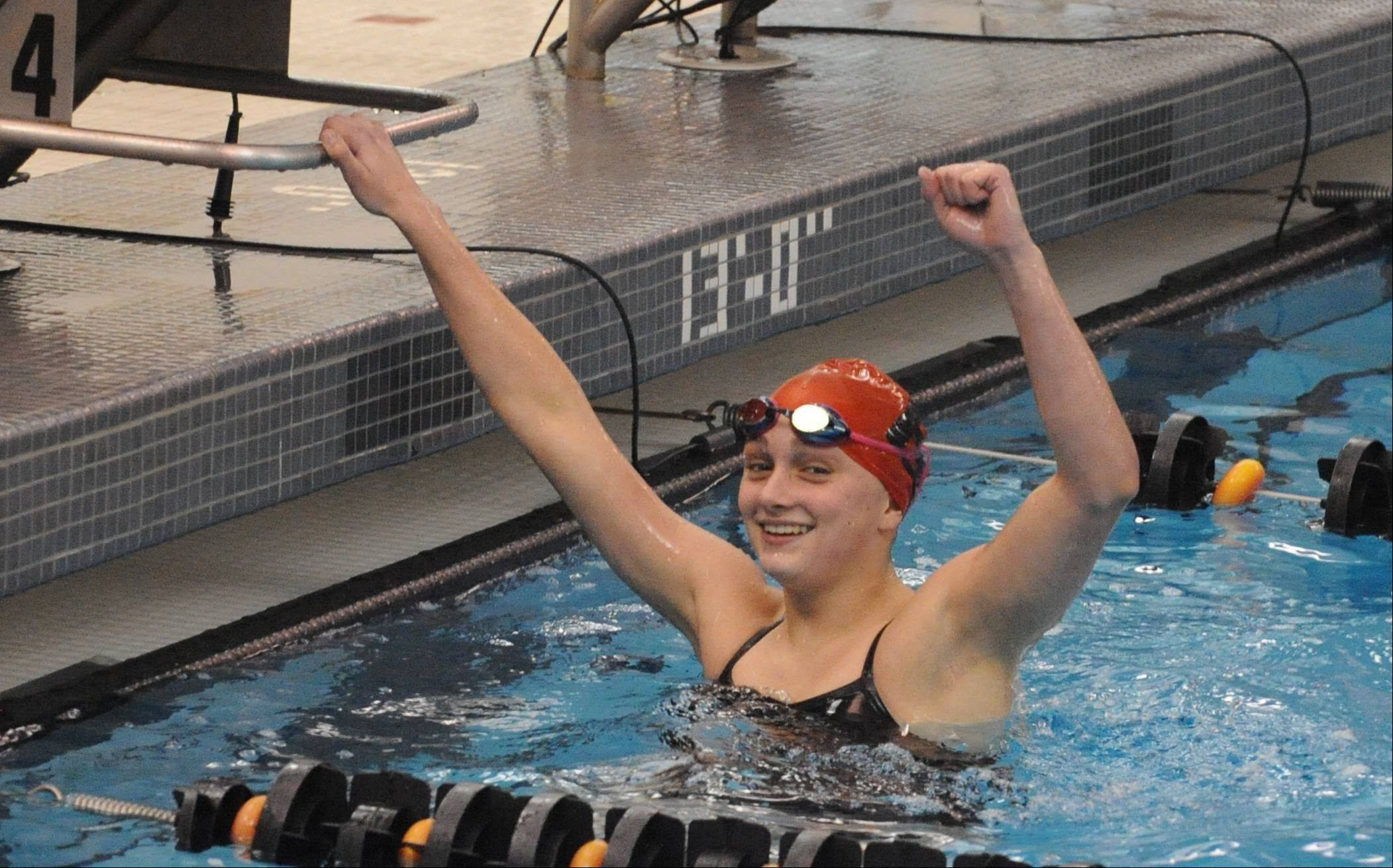 Barrington junior Mekenna Scheitlin celebrates a winning effort in the 50-yard freestyle during Saturday's Mid-Suburban League meet at Barrington.