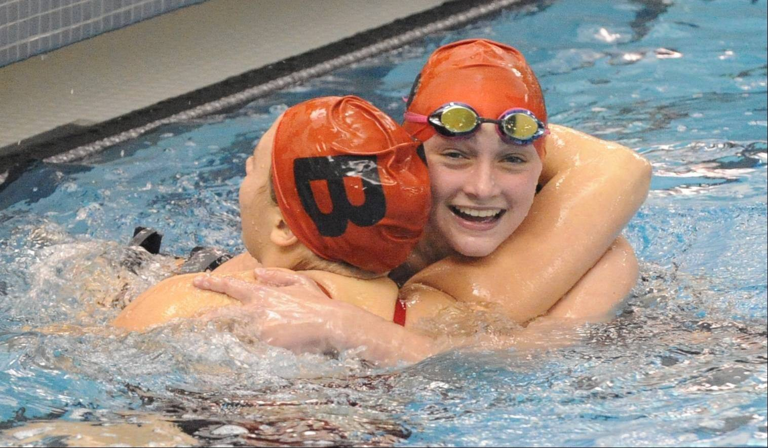 Barrington's Mekenna Scheitlin, right, and Olivia Hoffman celebrate a 1-2 finish in the 100-yard butterfly during Saturday's Mid-Suburban League meet at Barrington.