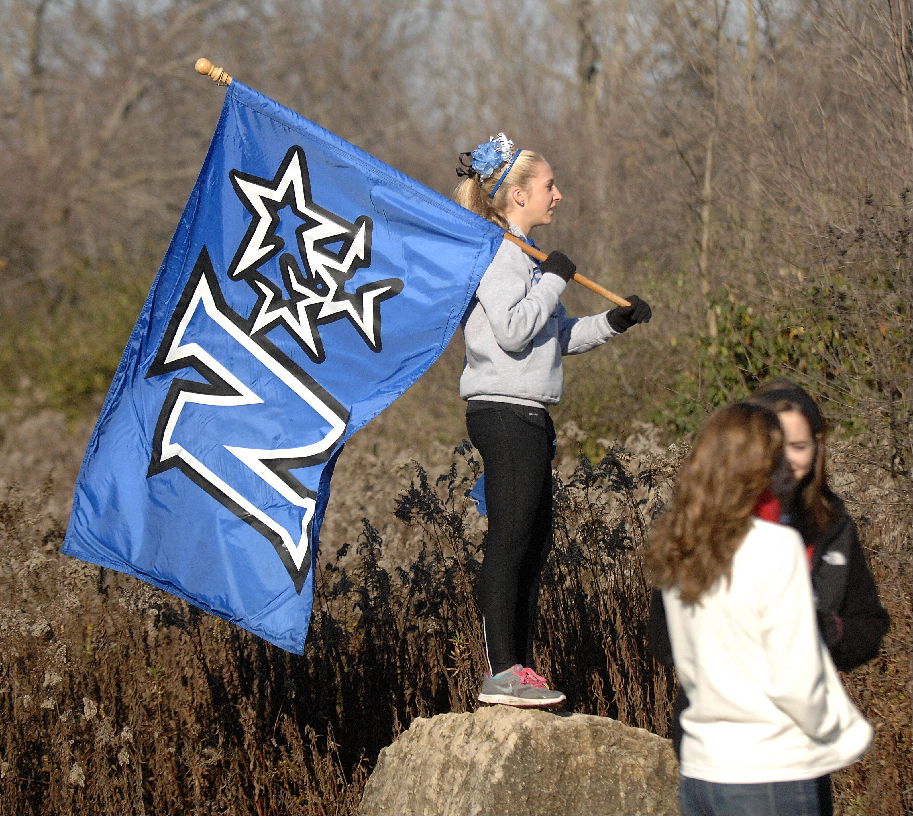 A St. Charles North supporter waits for the start of the girls race in the St. Charles East cross country sectional at LeRoy Oakes in St. Charles on Saturday, October 27.