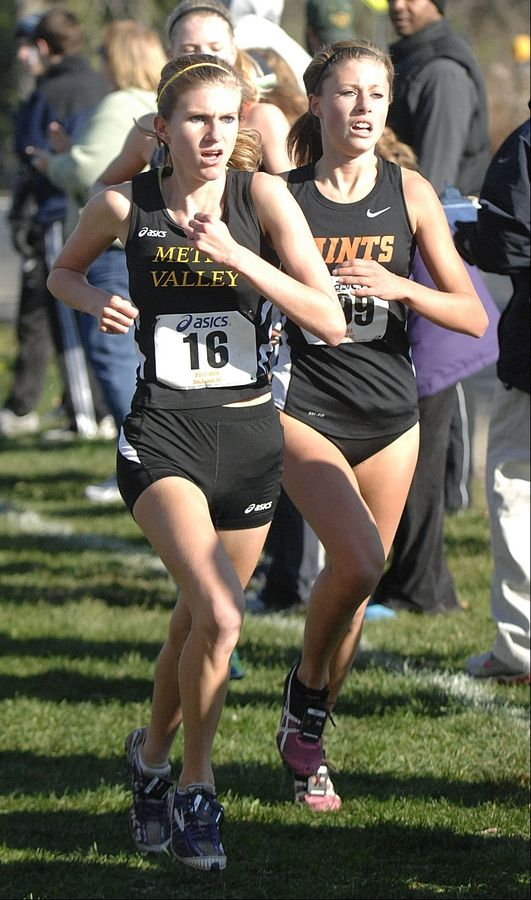 Metea Valley's Kendall Cast and St. Charles East' Torree Scull near the mile and a half mark in the cross country sectional at LeRoy Oakes in St. Charles on Saturday, October 27.