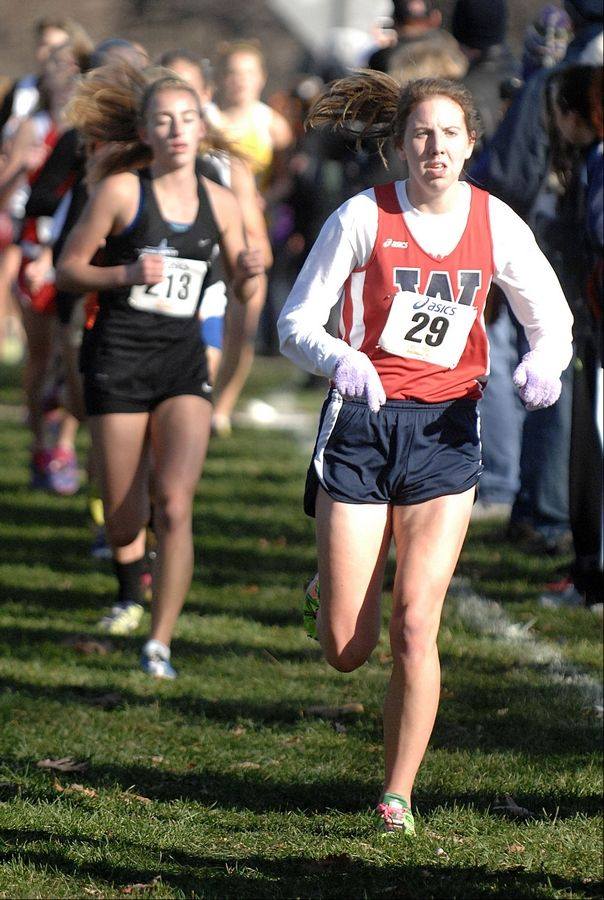 West Aurora's Claire Loran near the mile and a half mark in the St. Charles East cross country sectional at LeRoy Oakes in St. Charles on Saturday, October 27.