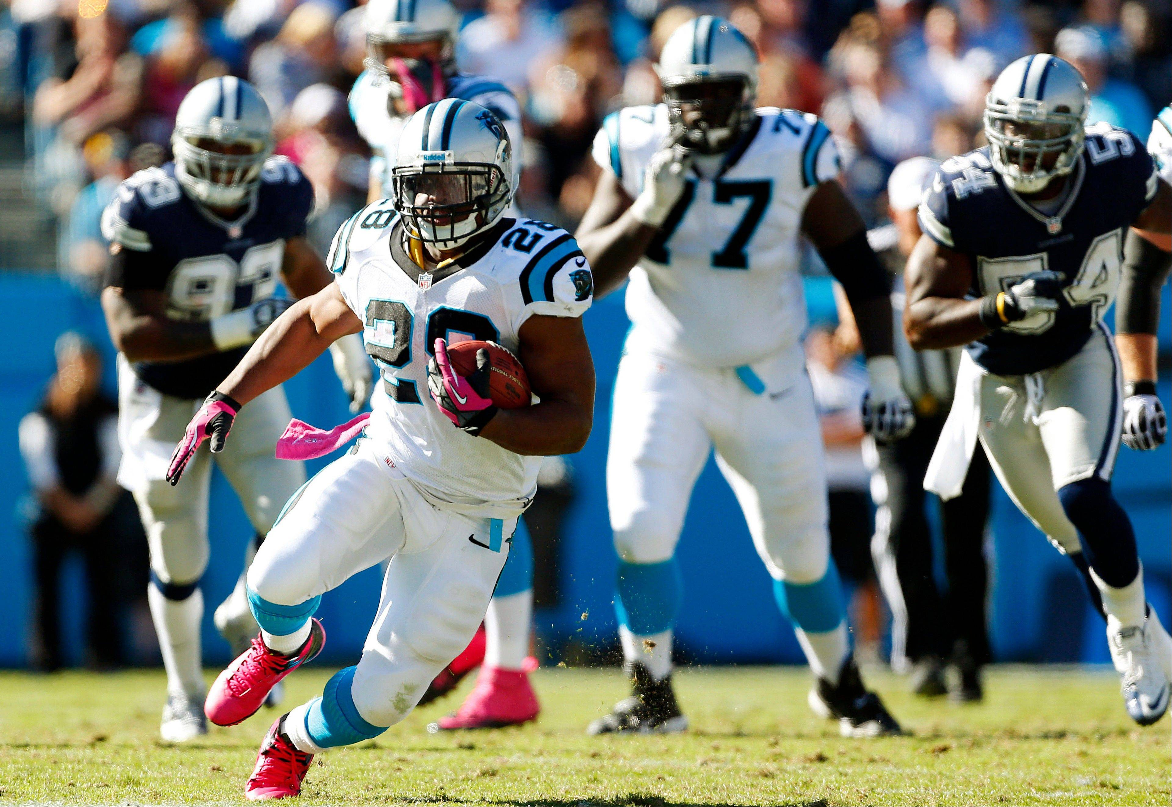 Carolina Panthers running back Jonathan Stewart (28) rushes upfield against the Dallas Cowboys during the second half of an NFL football game, Sunday, Oct. 21, 2012, in Charlotte, N.C.