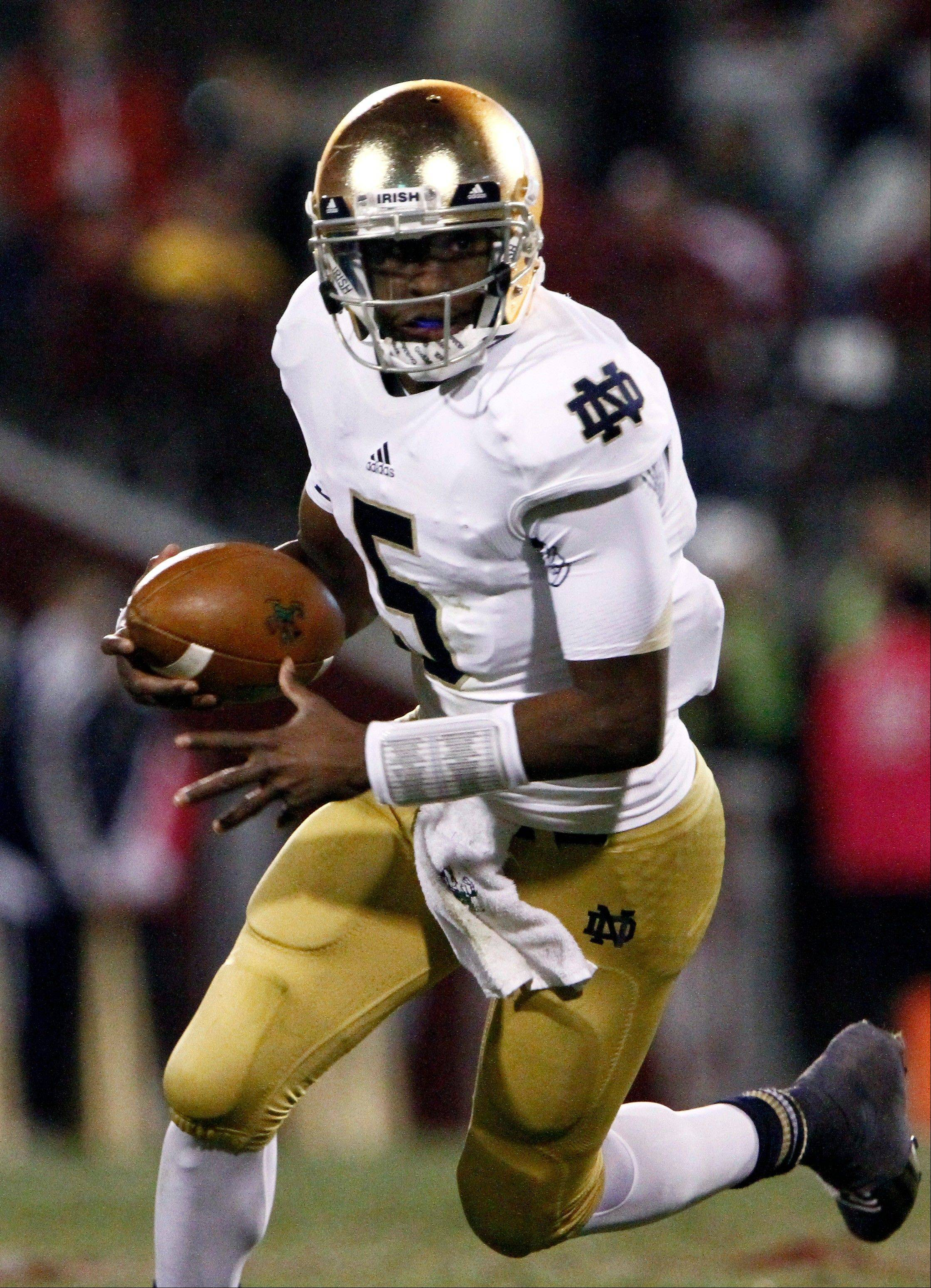 Everett Golson threw for 177 yards and plunged in for the decisive 1-yard touchdown in the fourth quarter, Manti Te'o bolstered his Heisman Trophy candidacy with a late interception and No. 5 Notre Dame beat No. 8 Oklahoma 30-13 on Saturday night to remain undefeated.