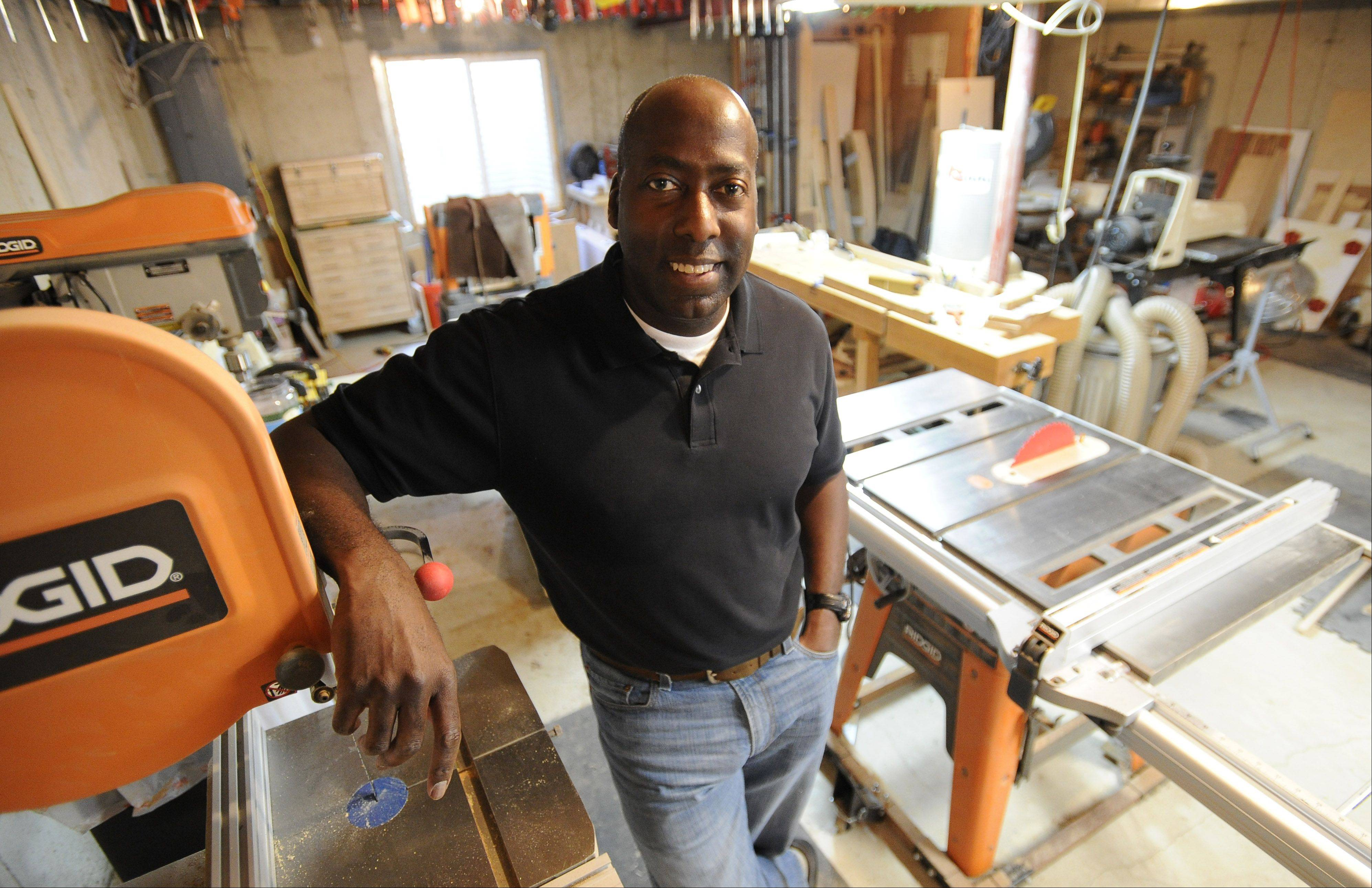 Hoffman Estates resident Gerald Adams, shown here in his basement workshop, opened Custom Wood Accents shortly before the lengthy recession hit.