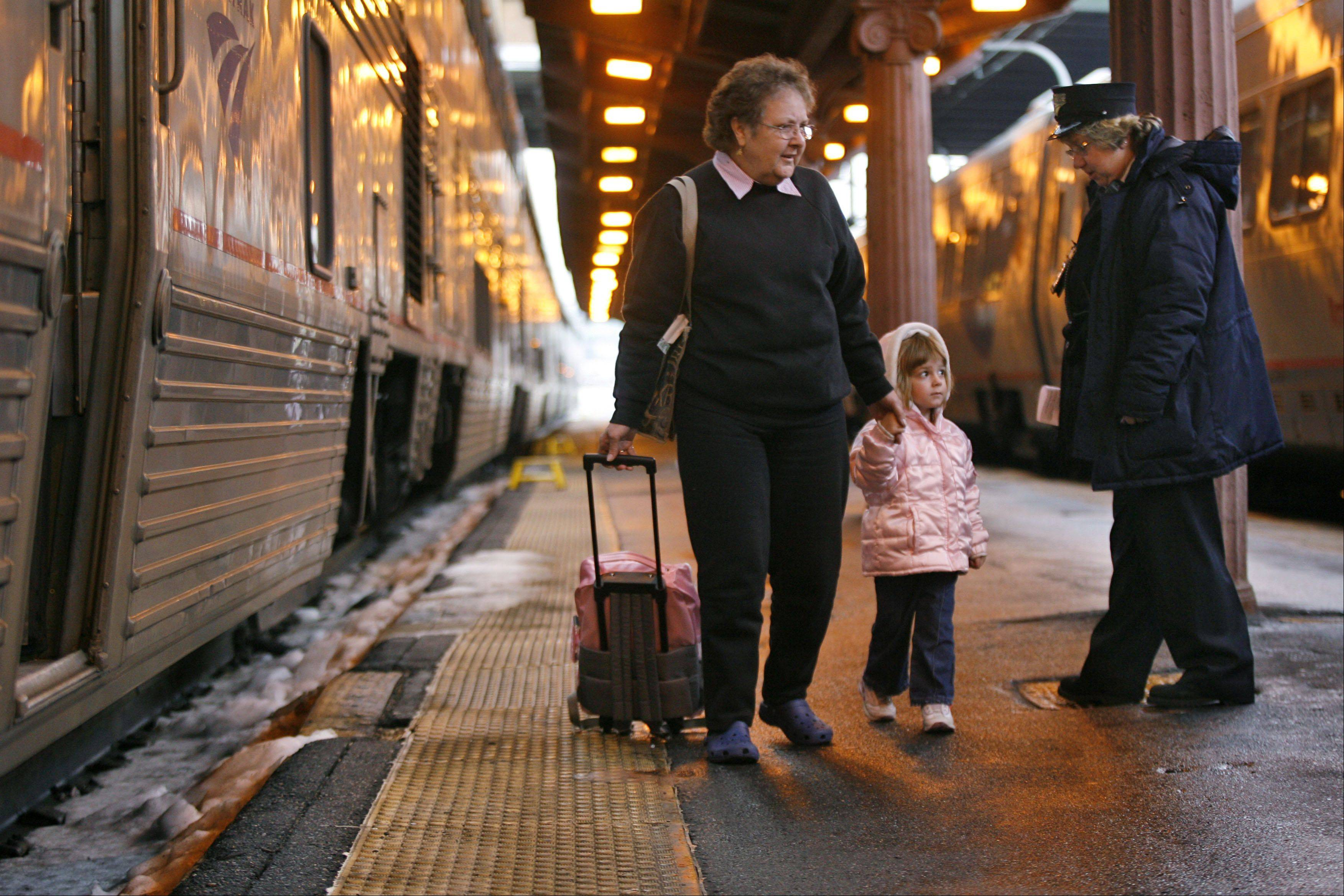 Anticipating heavy rain associated with Hurricane Sandy, Amtrak is curtailing its service along the Eastern Seaboard.
