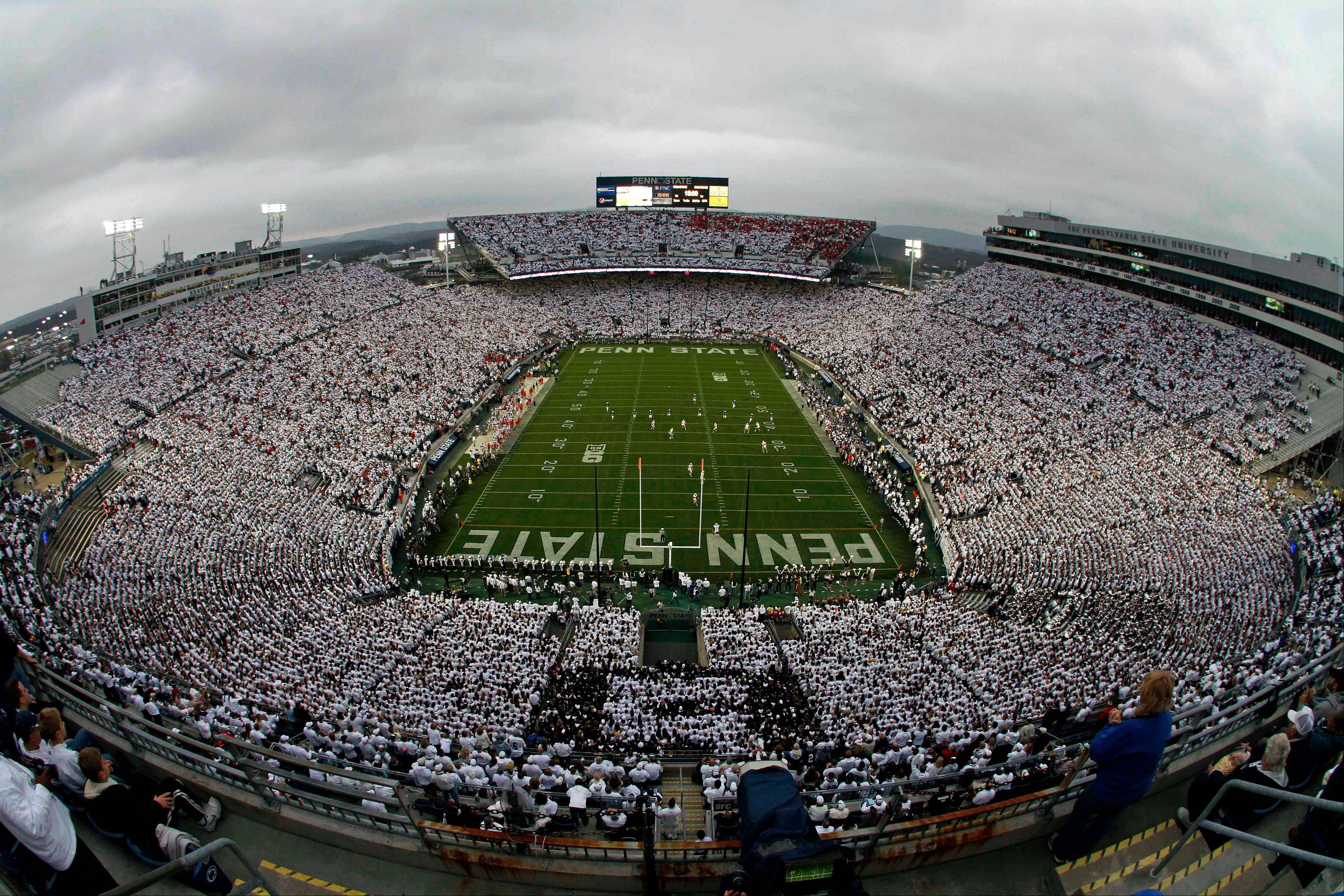 Penn State kicks off to Ohio State before the start of an NCAA college football game at Beaver Stadium in State College, Pa., Saturday.