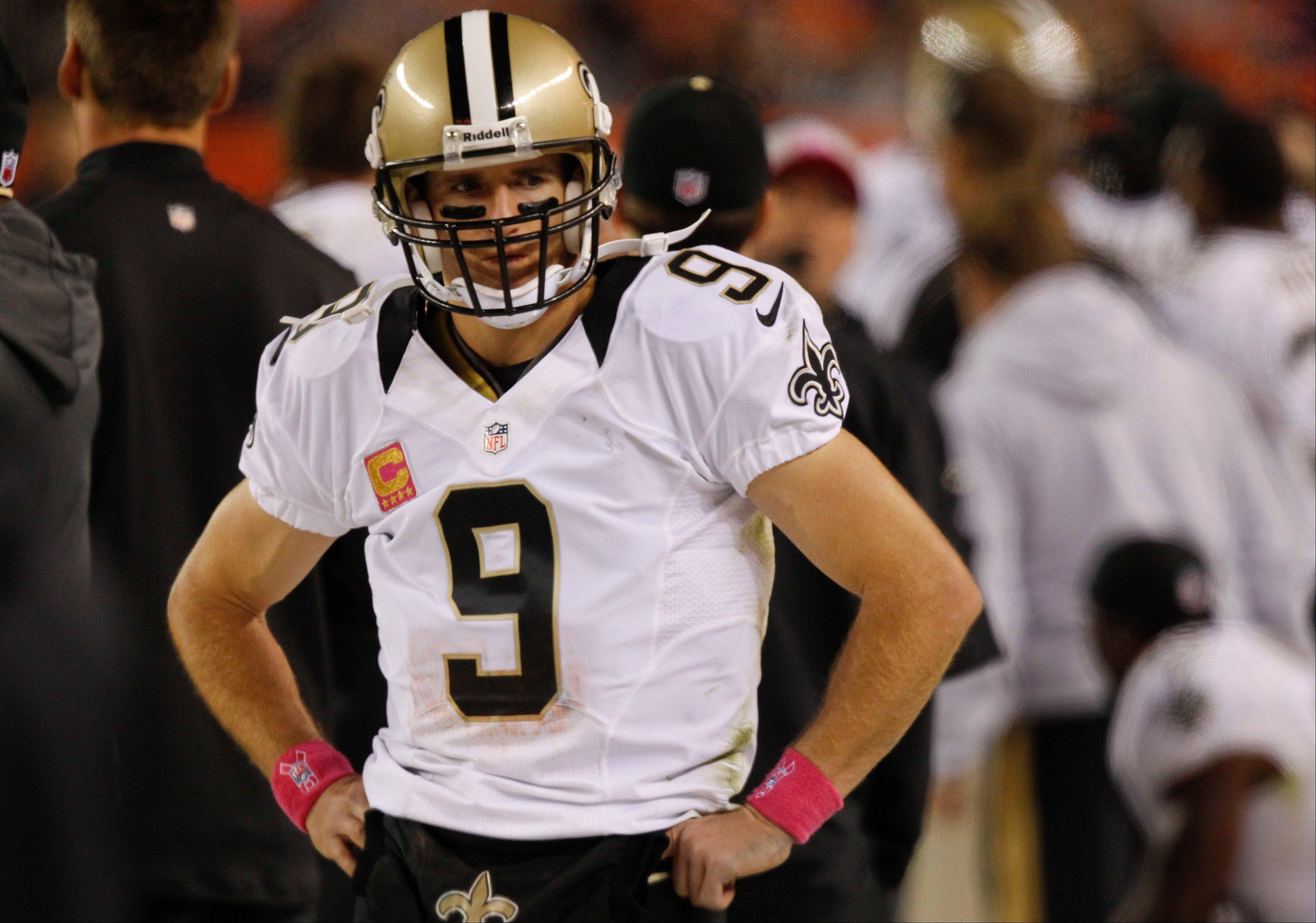 New Orleans Saints quarterback Drew Brees (9) stands on the sidelines in the fourth quarter of an NFL football game against the Denver Broncos, Sunday, in Denver.