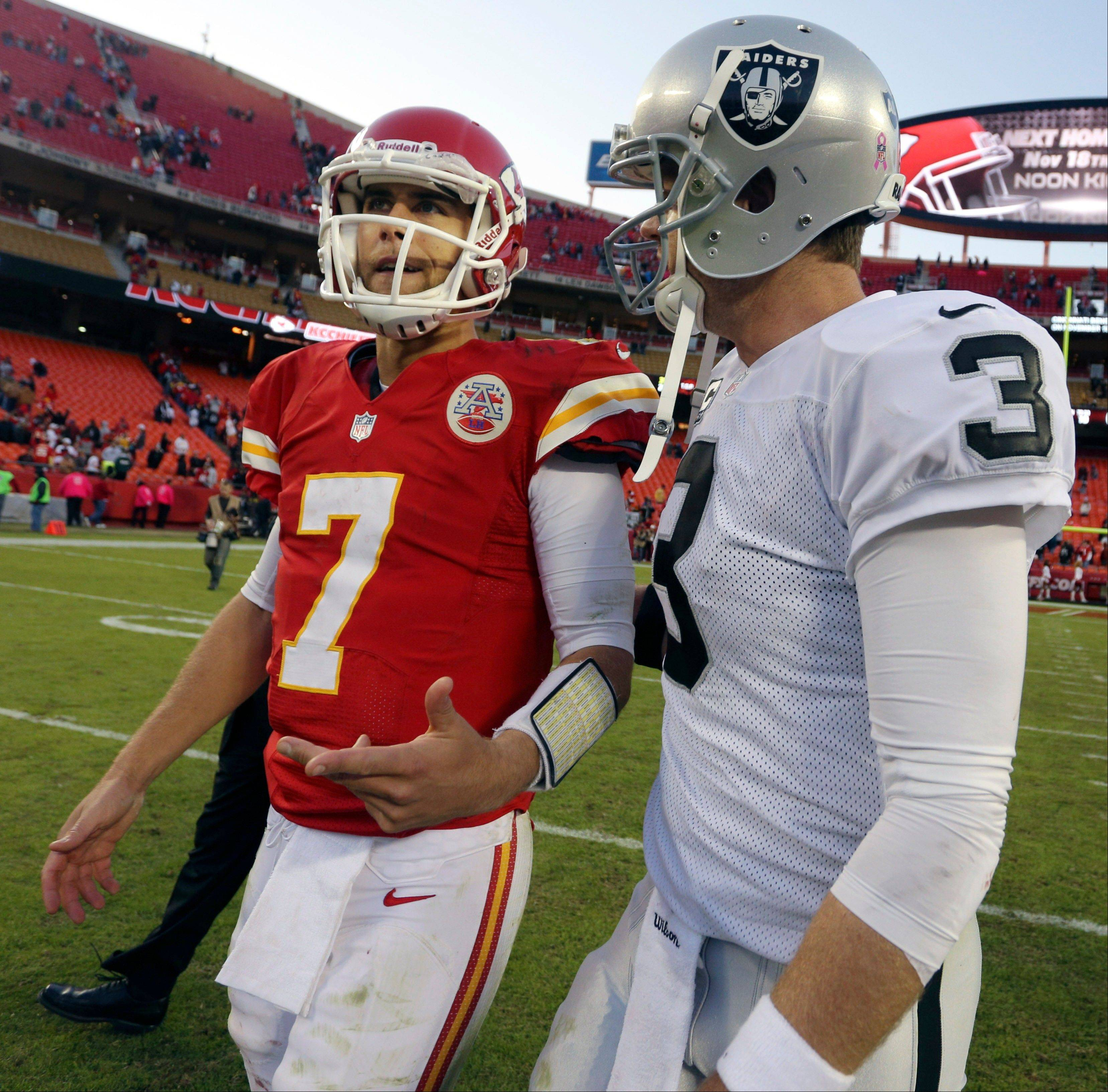 Kansas City Chiefs quarterback Matt Cassel (7) and Oakland Raiders quarterback Carson Palmer (3) talk following an NFL football game at Arrowhead Stadium in Kansas City, Mo., Sunday. The Raiders defeated the Chiefs 26-16.