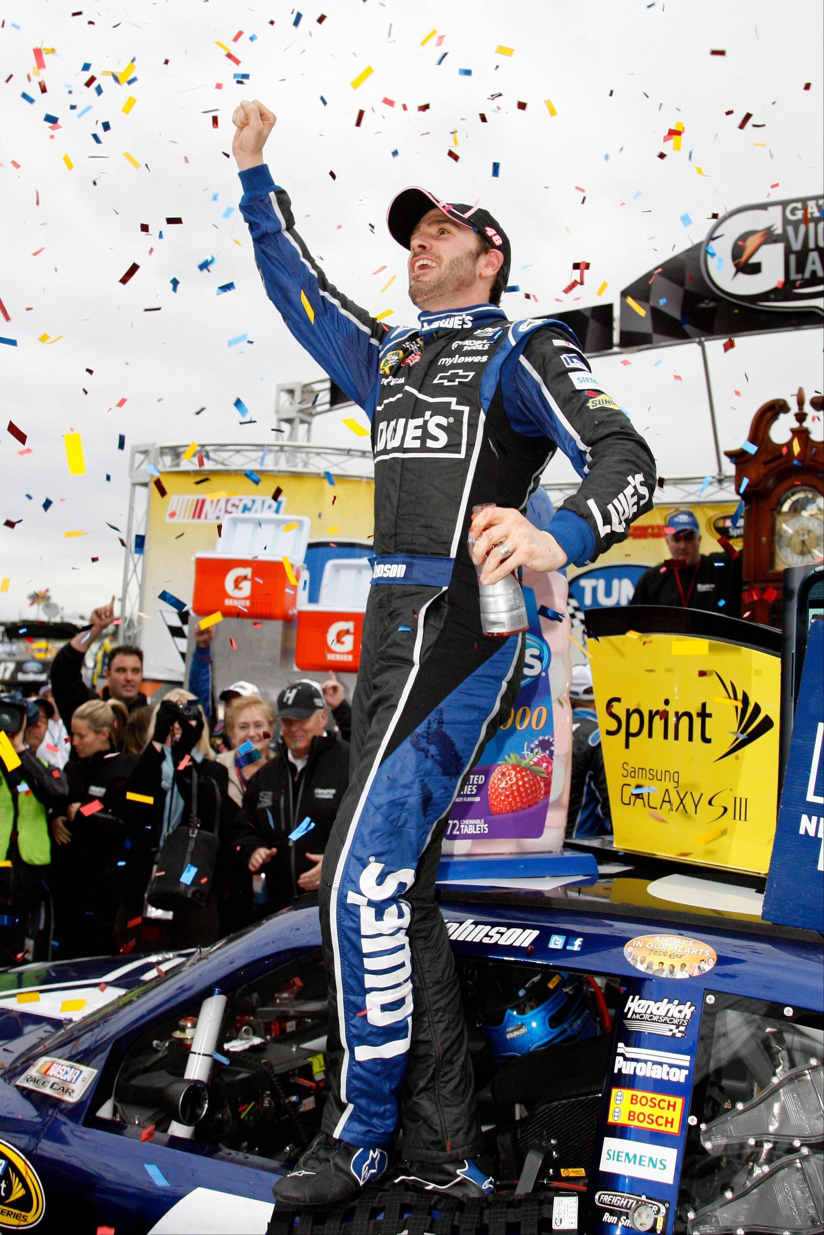 Jimmie Johnson celebrates his win after the NASCAR Sprint Cup Series auto race at Martinsville Speedway, Sunday, in Martinsville, Va.
