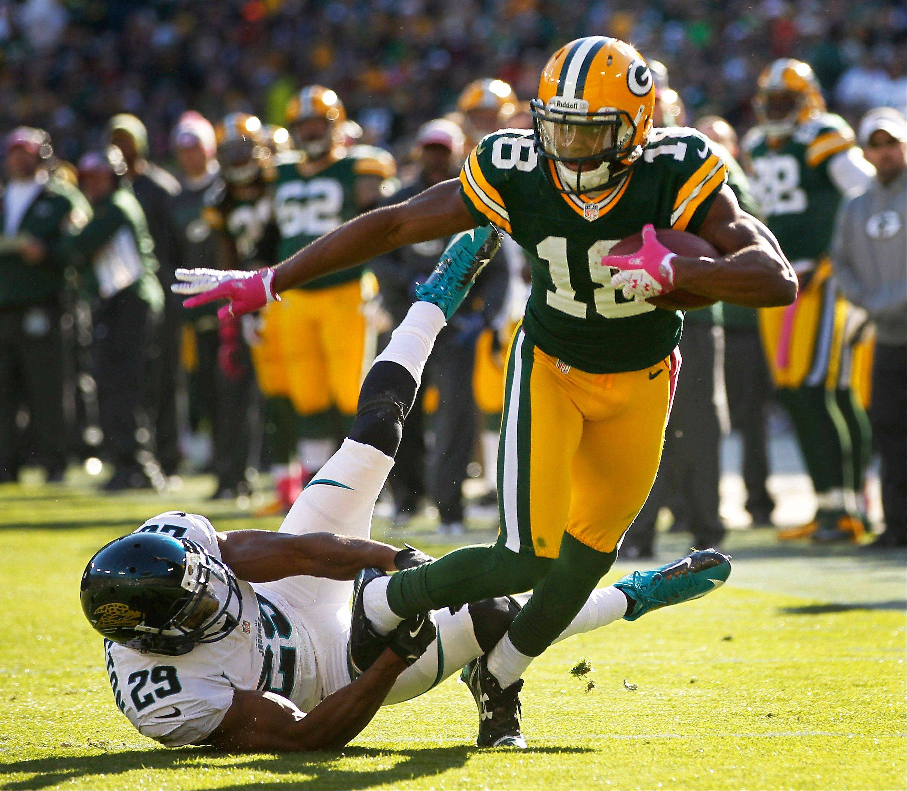 Green Bay Packers wide receiver Randall Cobb tries to get away from Jacksonville Jaguars cornerback William Middleton during the second half in Green Bay, Wis. The Packers won 24-15.