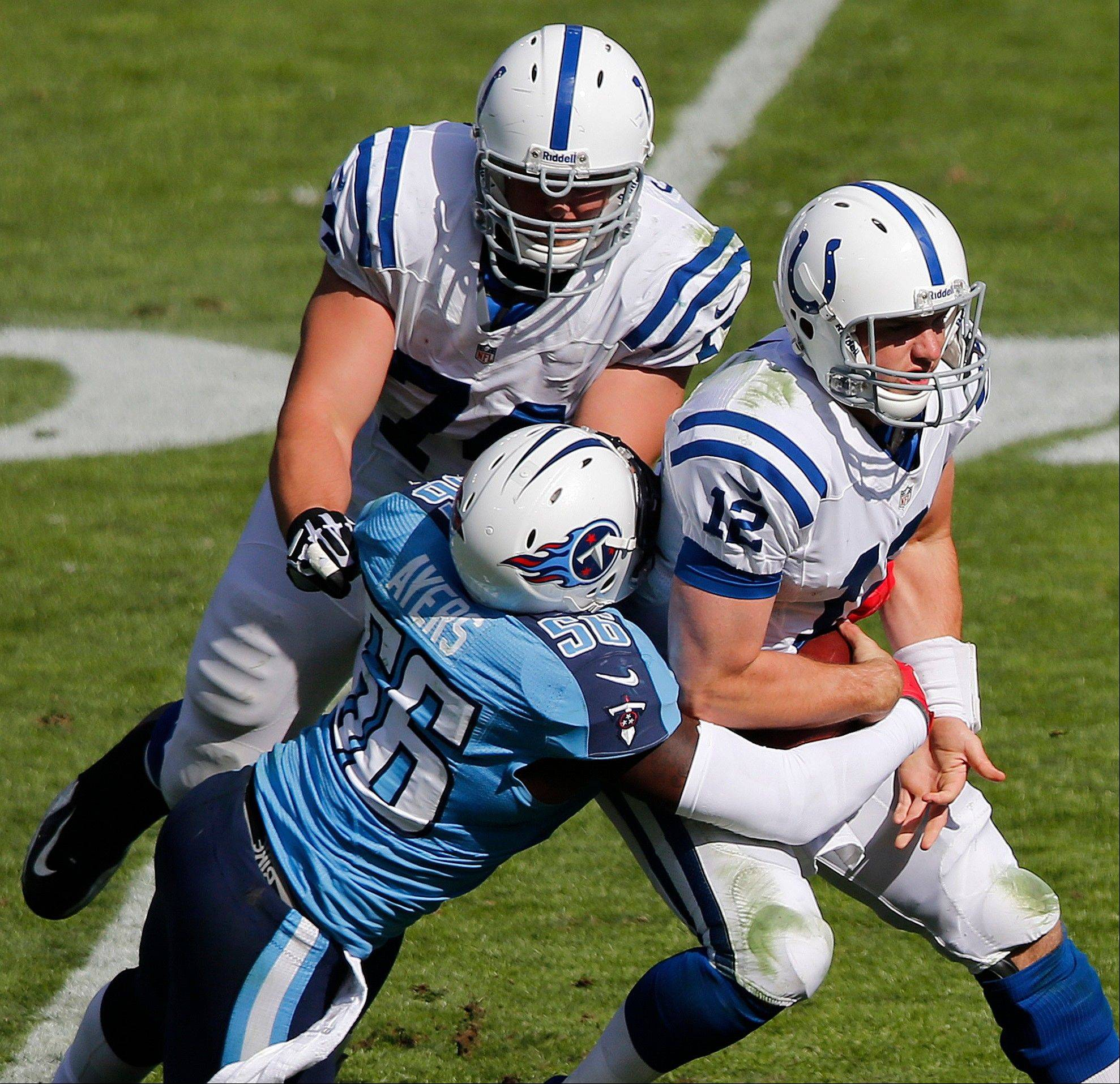 Indianapolis Colts quarterback Andrew Luck (12) is sacked by Tennessee Titans outside linebacker Akeem Ayers (56) as Indianapolis Colts tackle Anthony Castonzo (74) blocks during the second half in Nashville, Tenn.