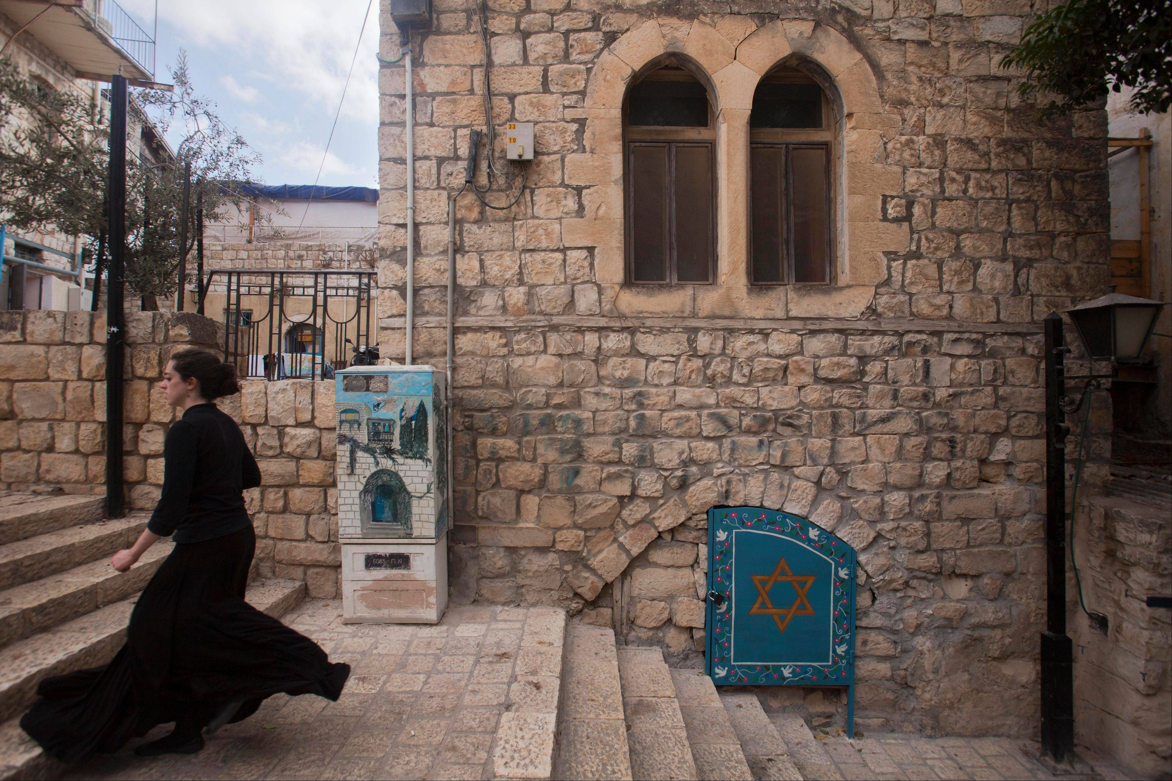 A woman walks the street of Safed, Israel in northern Israel. Safed is a popular destination for all kabbalah or Jewish mysticism, followers.