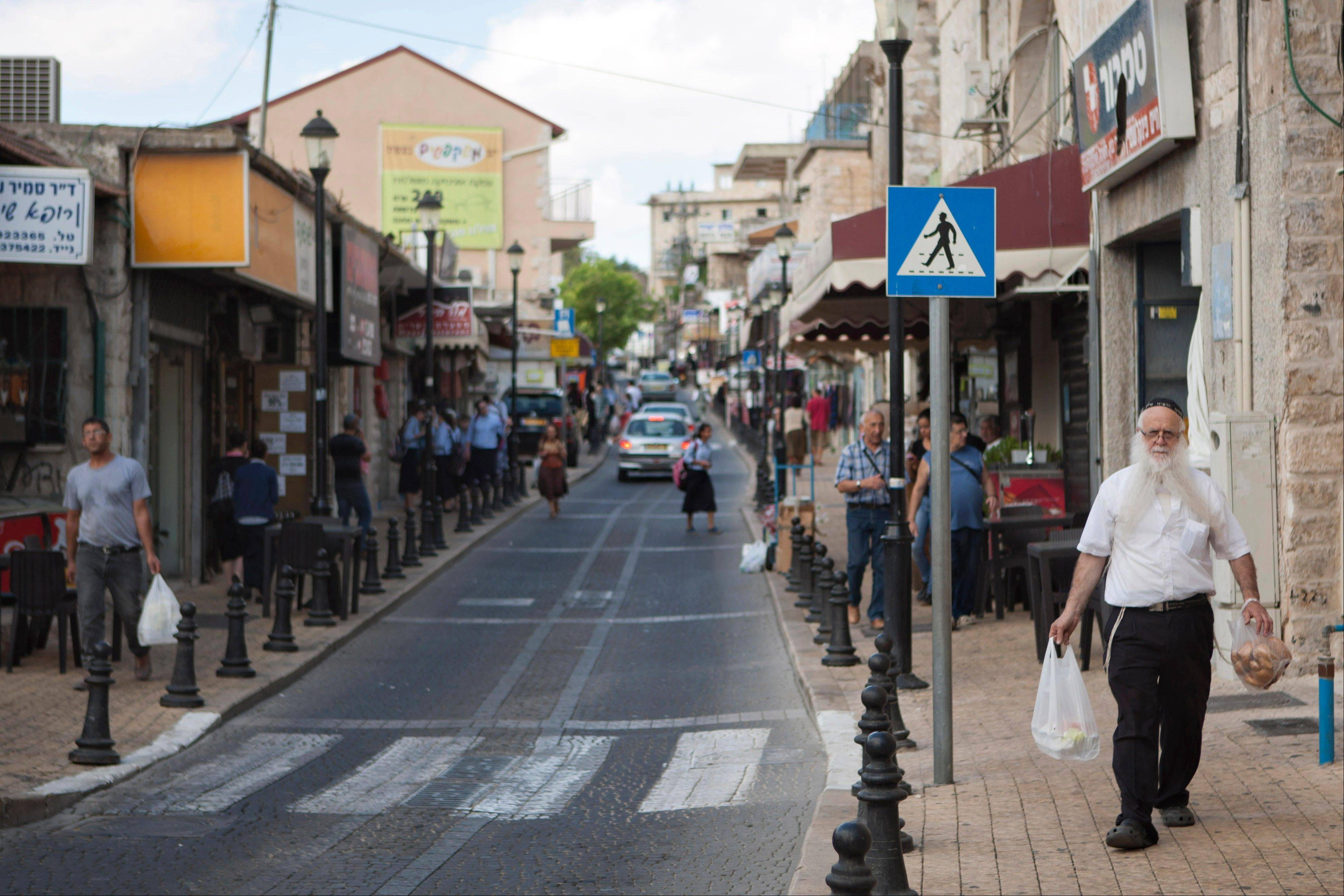 People walk the street of Safed, Israel. Its distant location, several hours from Tel Aviv and Jerusalem, doesn't stop hundreds of thousands of people from visiting each year to get up close with kabbalah's origins and the Jewish mystics who defined it 500 years ago.
