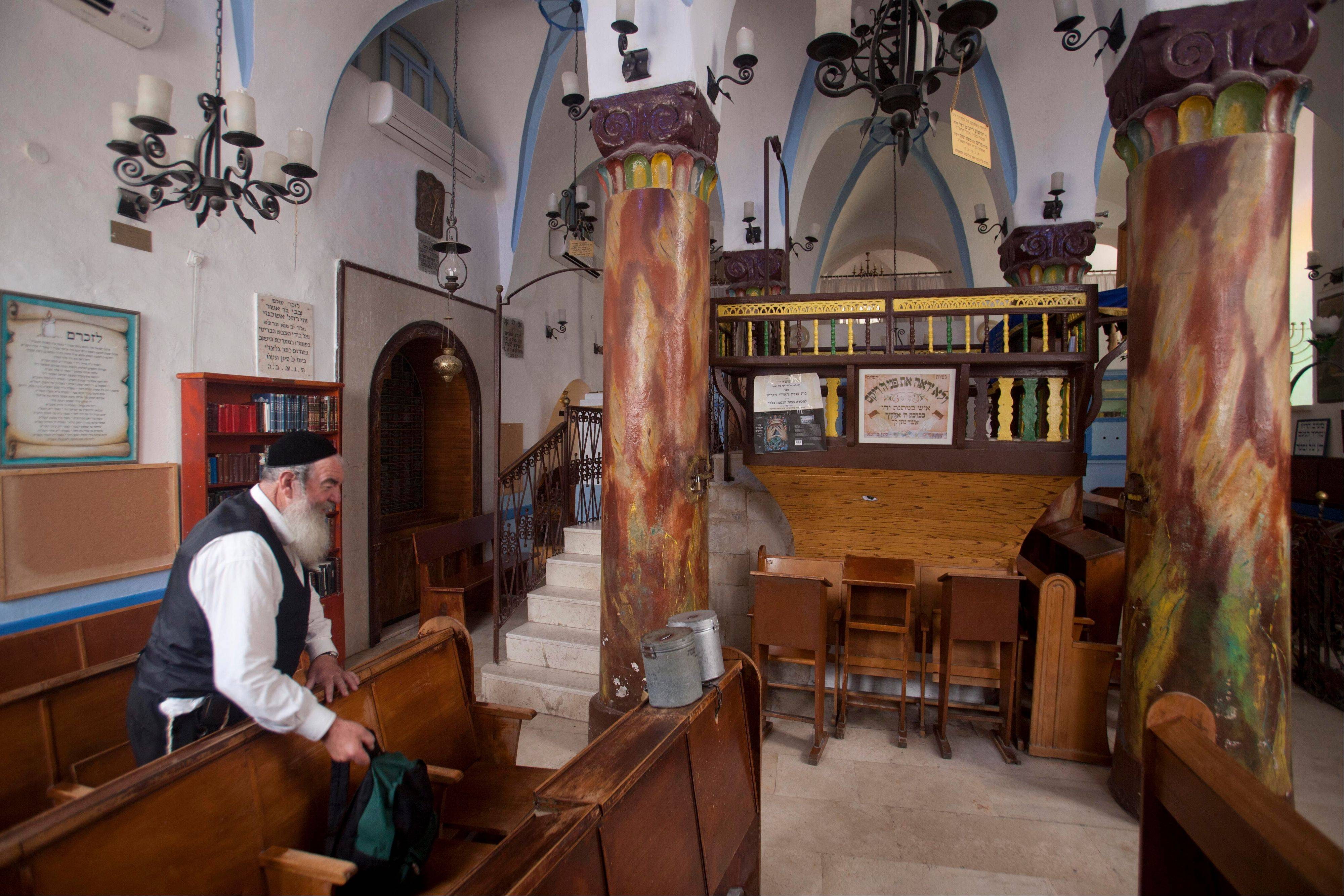 An Ultra Orthodox Jew stands in the Ari Ashkenazi Synagogue in Safed, Israel.