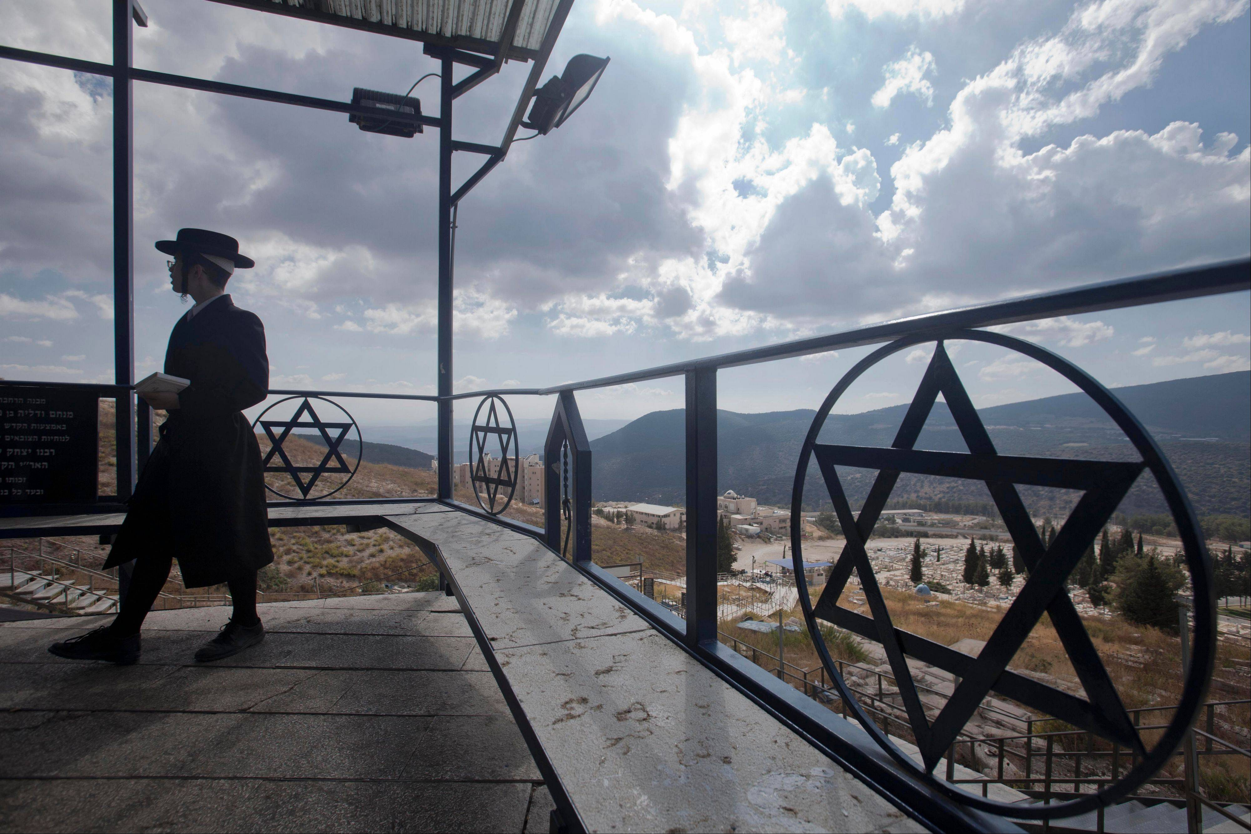 An Ultra orthodox Jew visits the Ari cemetery in Safed, Israel, a popular destination for all kabbalah. or Jewish mysticism, followers.