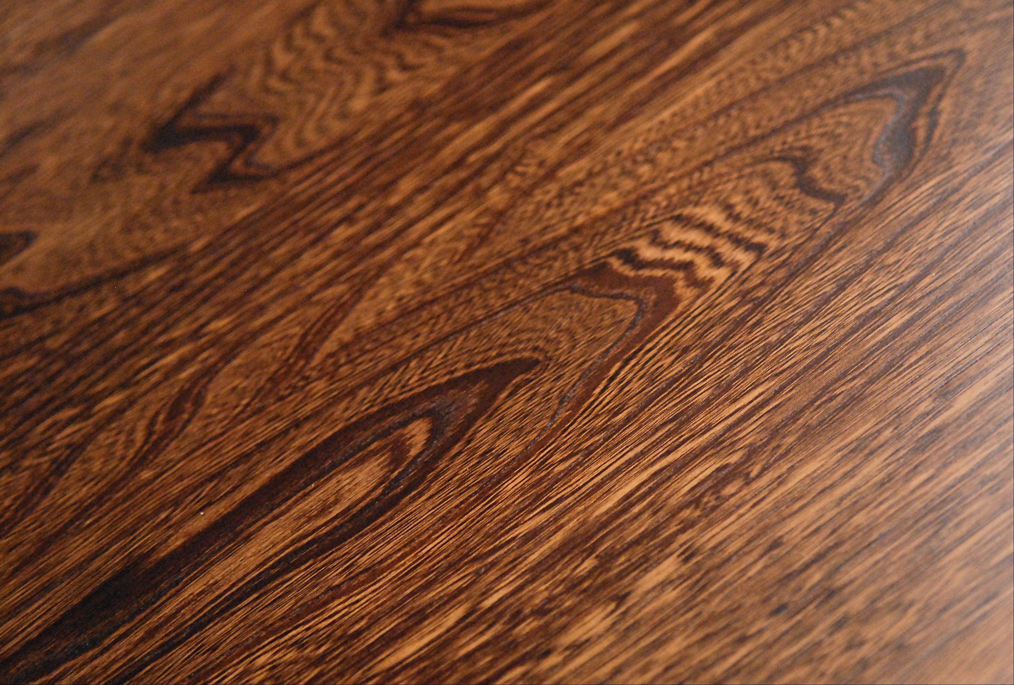 The unique design of Elm wood on a dining room table at Burress Amish Furniture in Elgin.