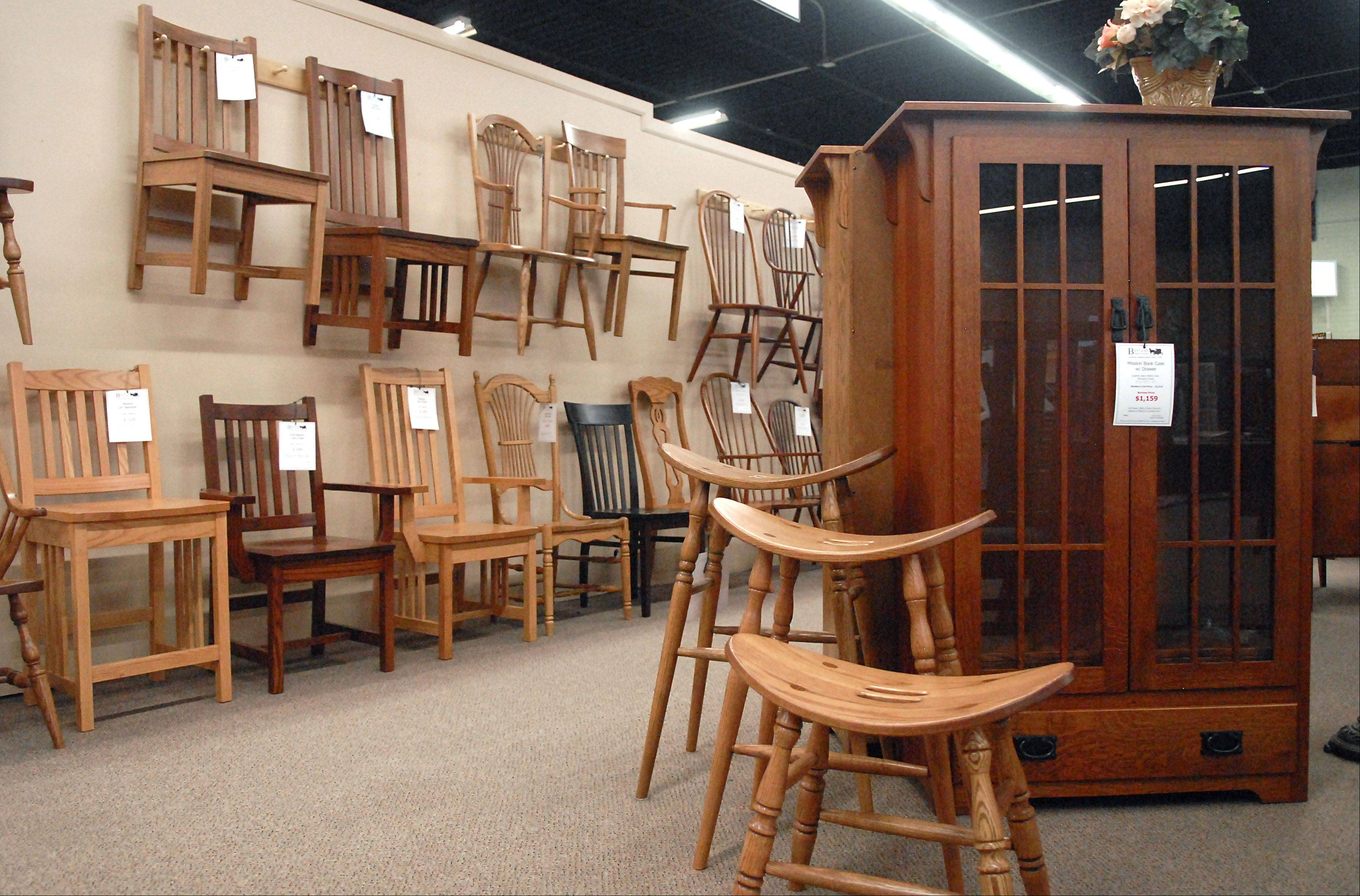 Different style chairs and curios at Burress Amish Furniture in Elgin.