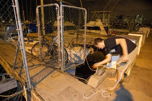 Tad Kanski of Newport Beach, Calif unties his family's sailboat moored at the Ala Wai Harbor after learning of a tsunami warning Saturday.